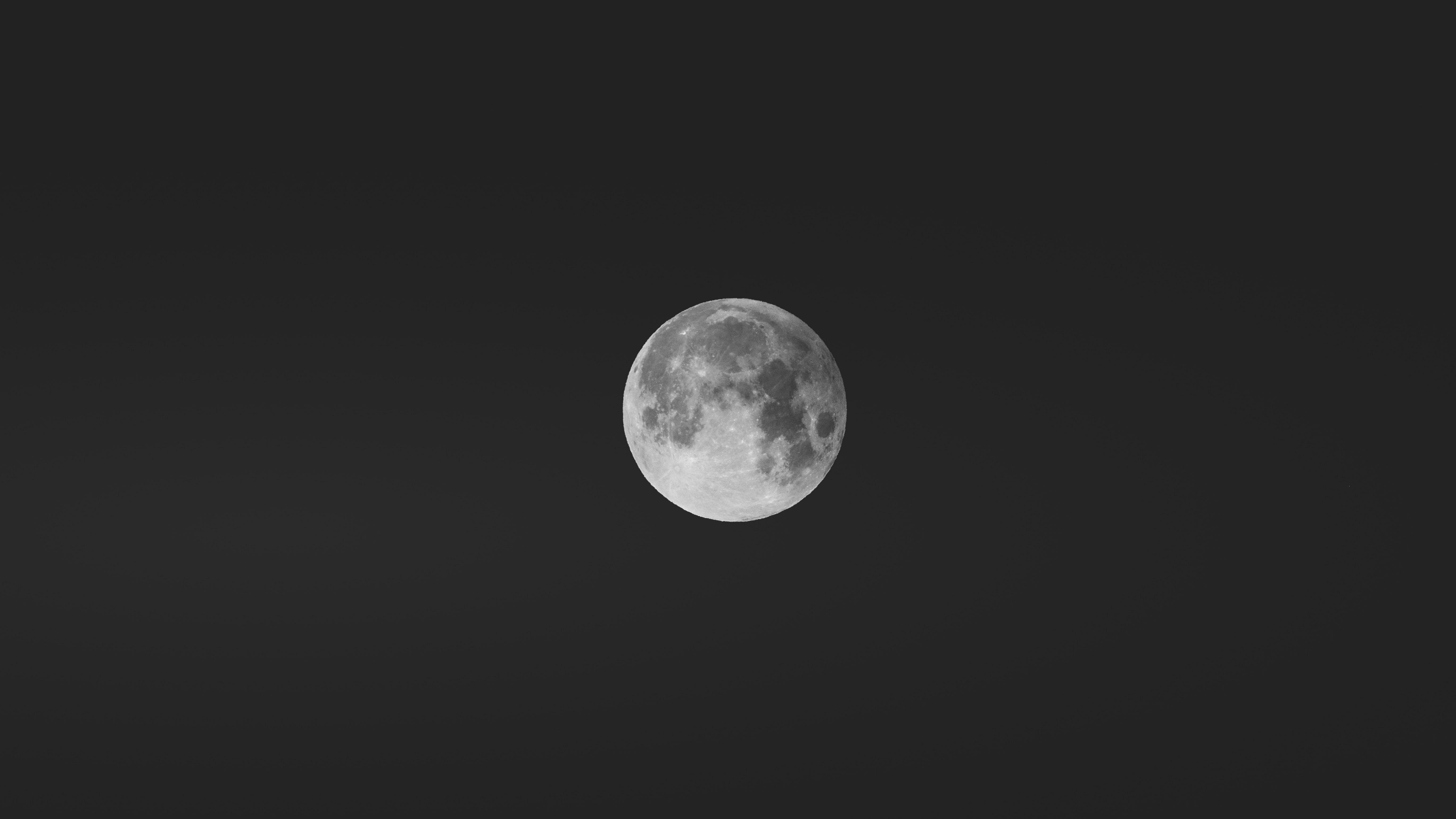 A focused shot on a full moon in a dark night sky in Innsbruck, Austria