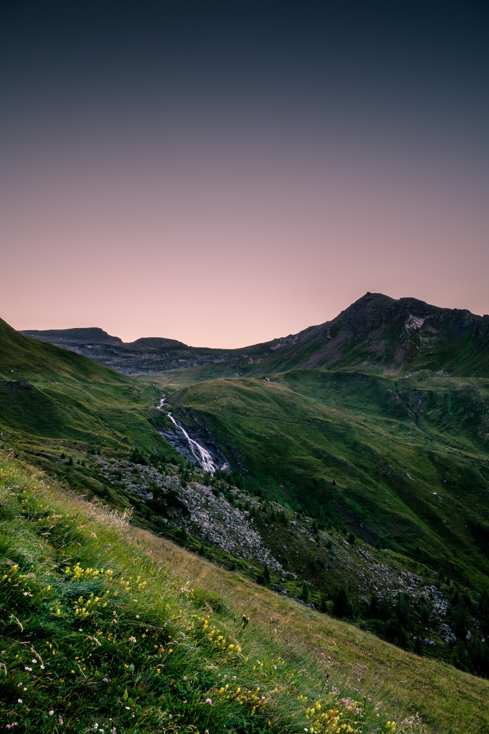 landscape photography of mountain range with river cascading