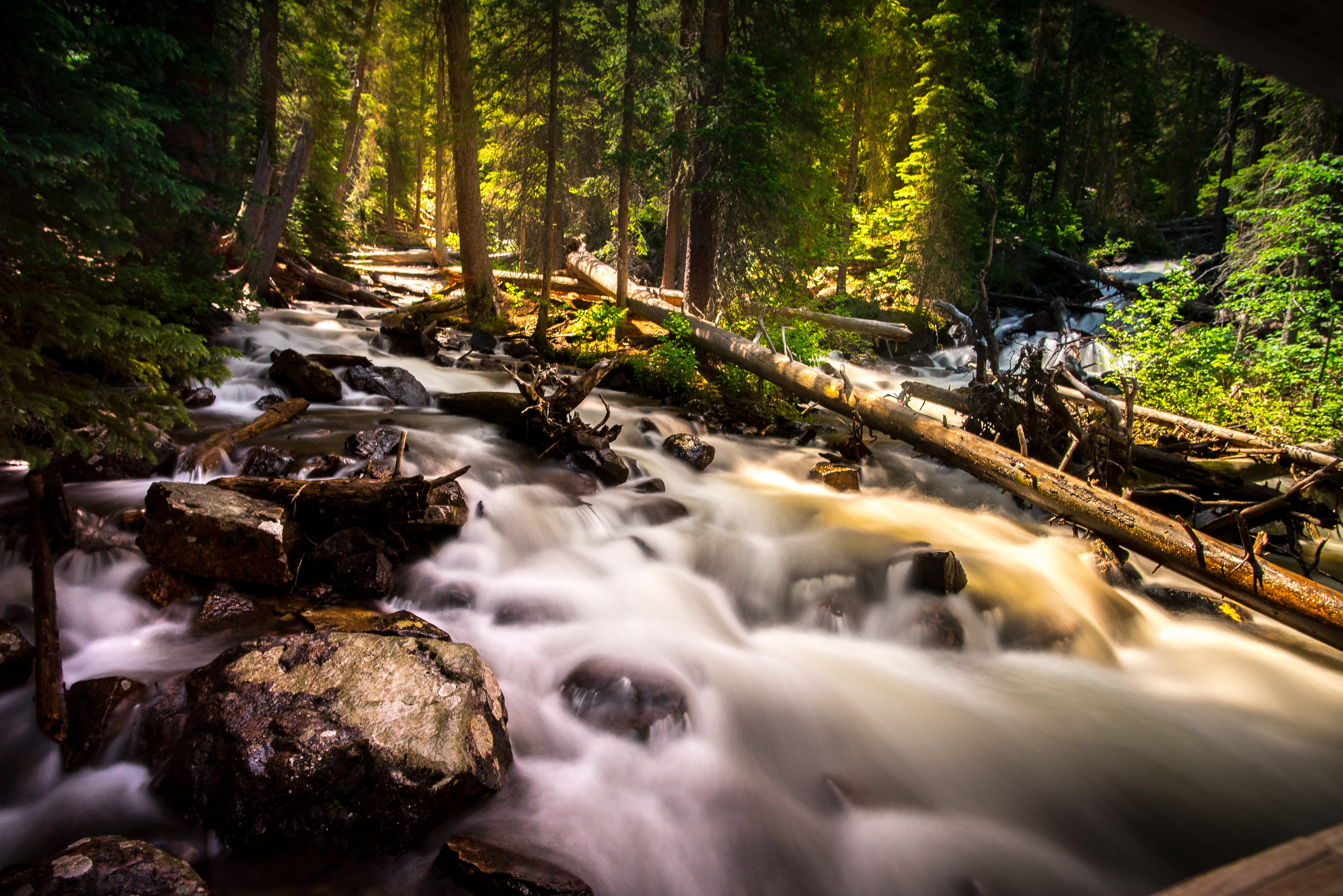 A view of a stream running downhill at Lower Cataract Lake in Colorado
