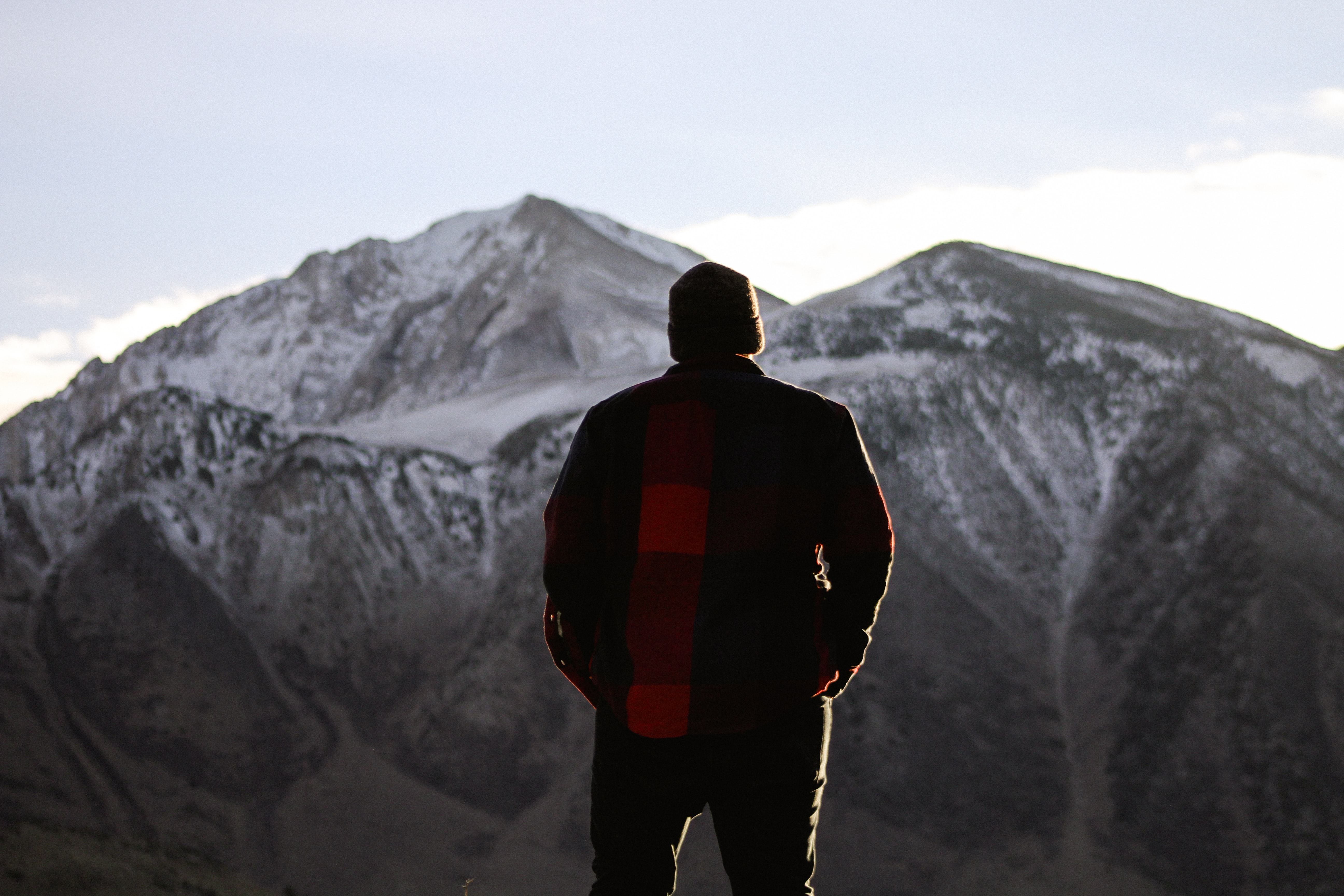 man standing while looking at the mountain