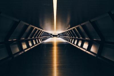 black tunnel with orange lights