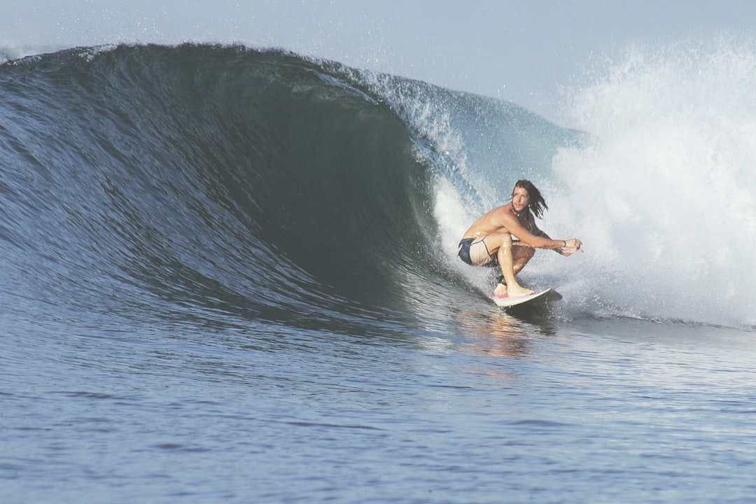 Crouching surfer in action