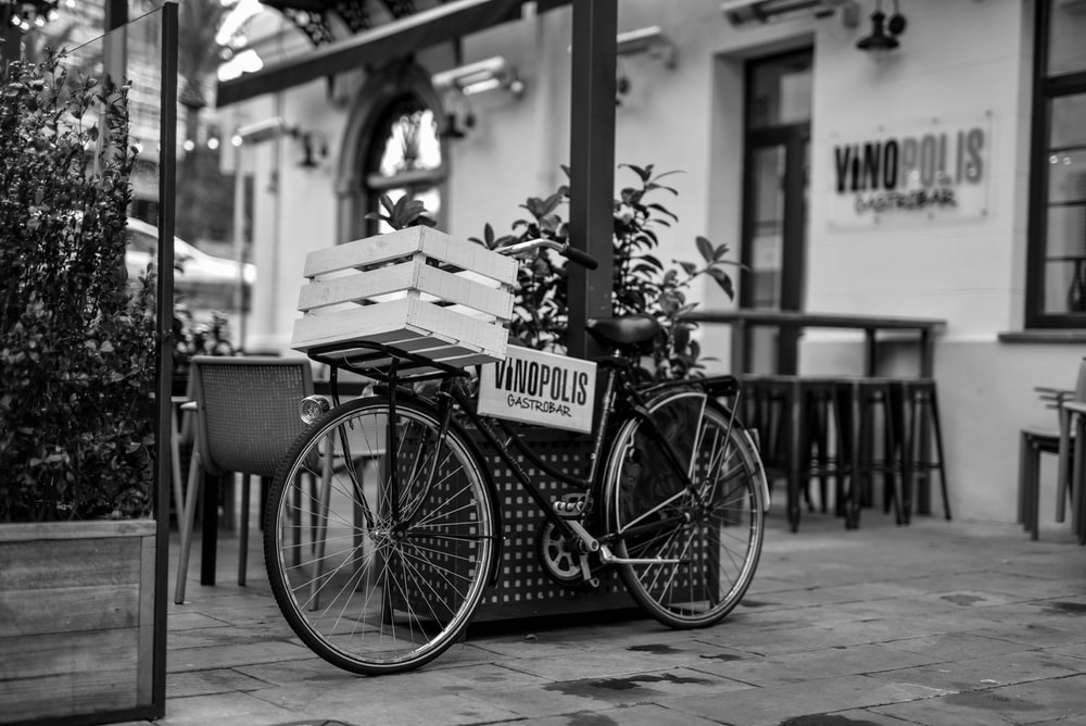 grayscale photo of a city bicycle