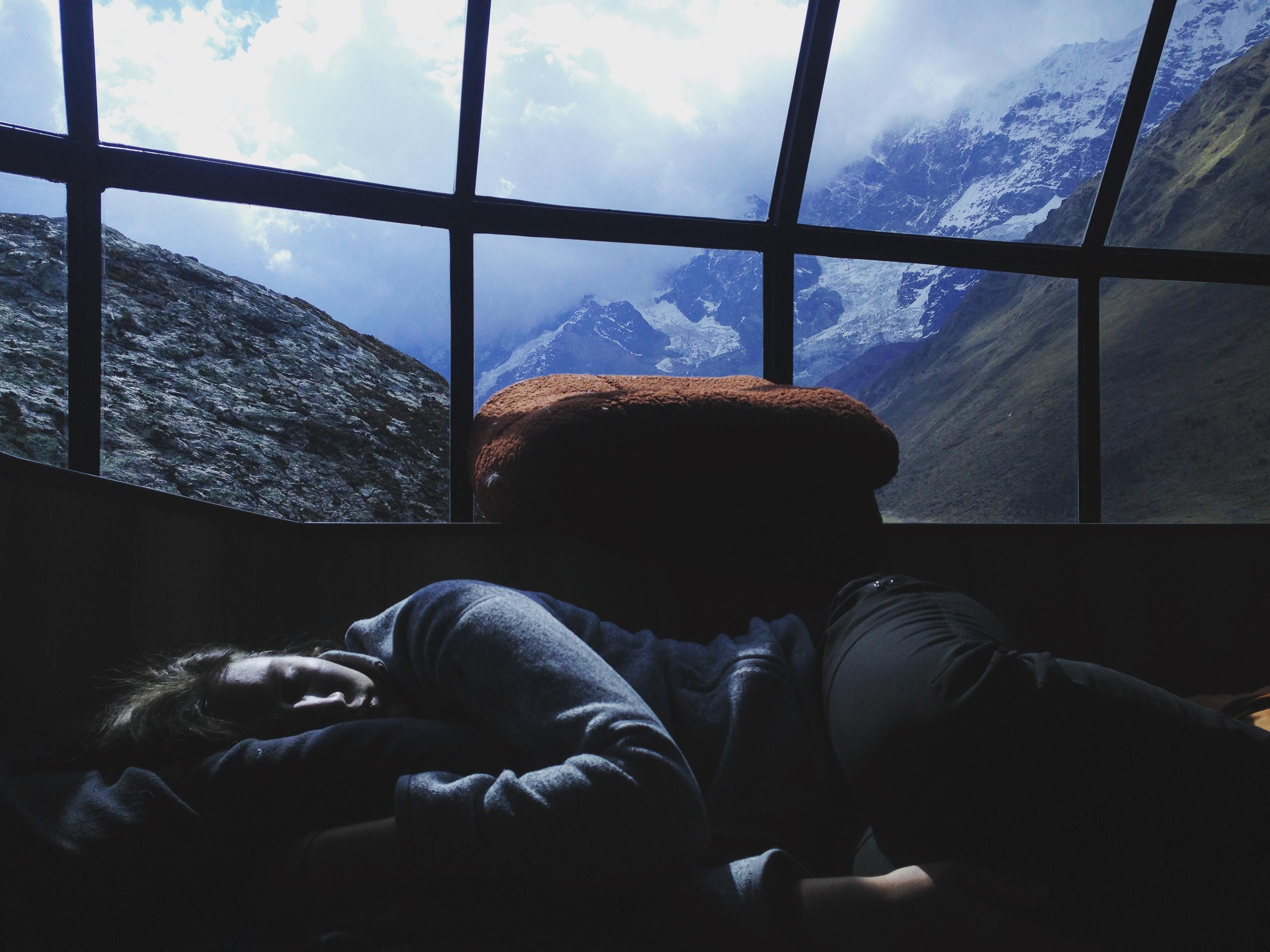 person sleeping near window
