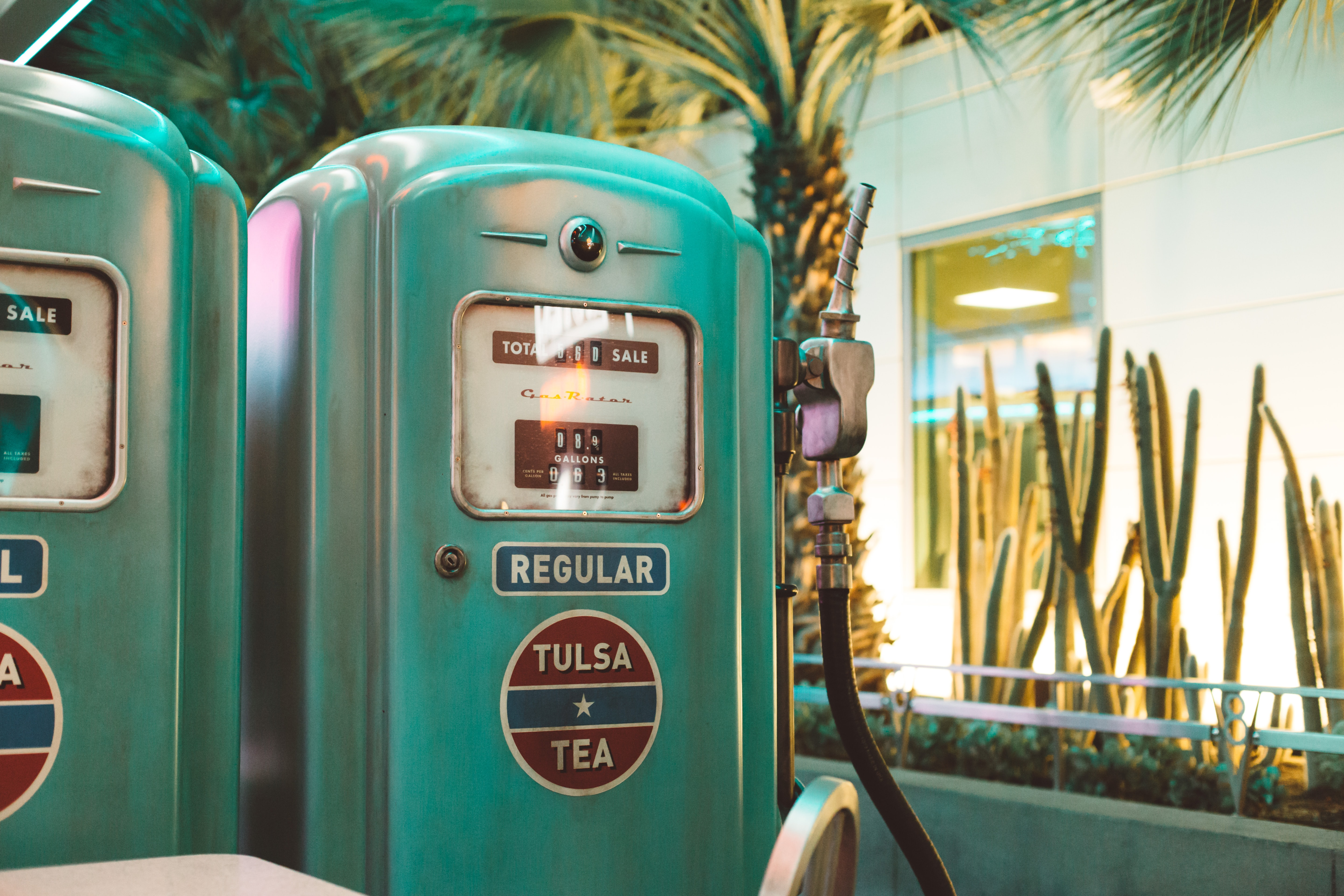 Retro turquoise gas pump at a beach town gas station