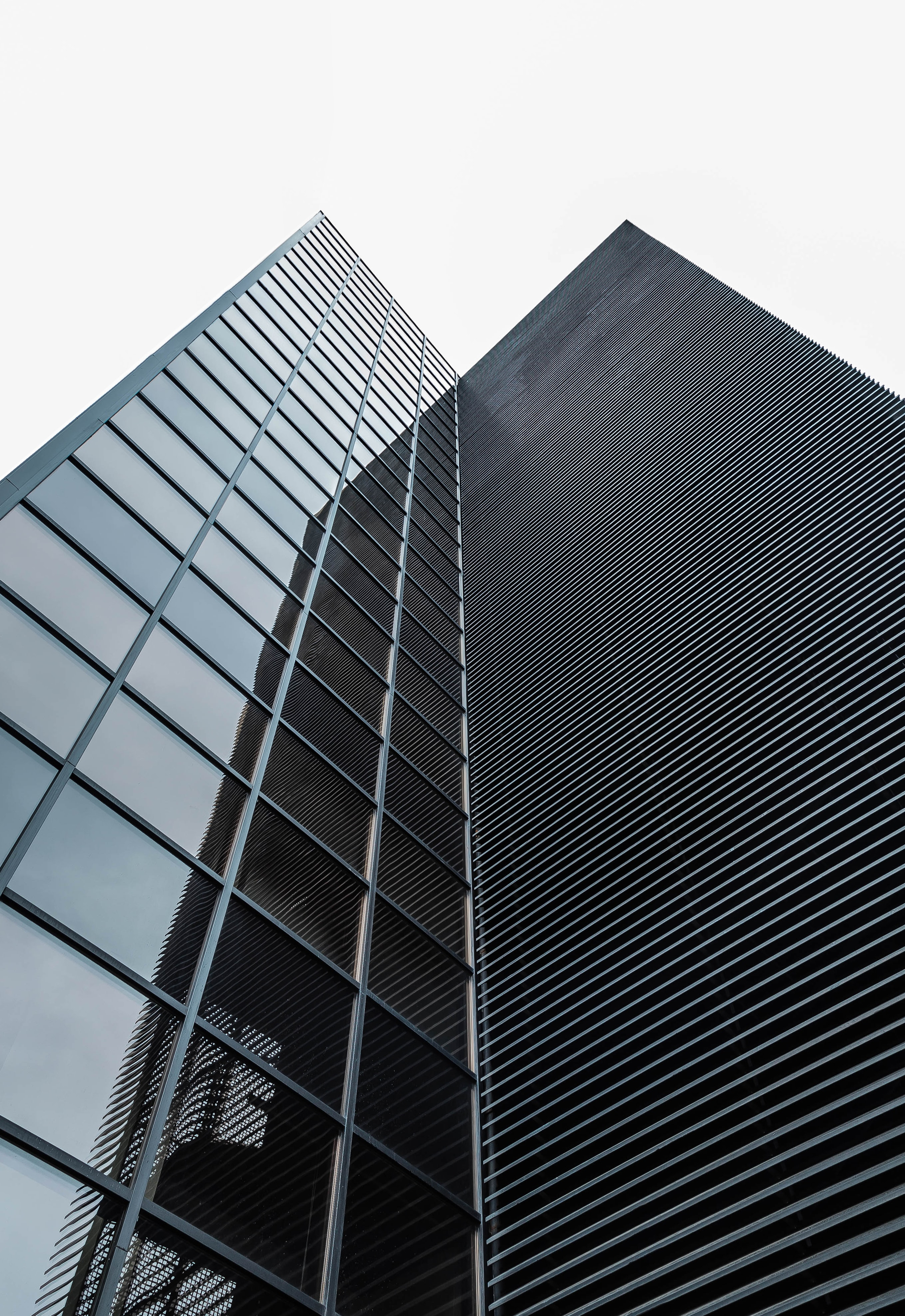 A corner of a modern office building facade with square glass windows