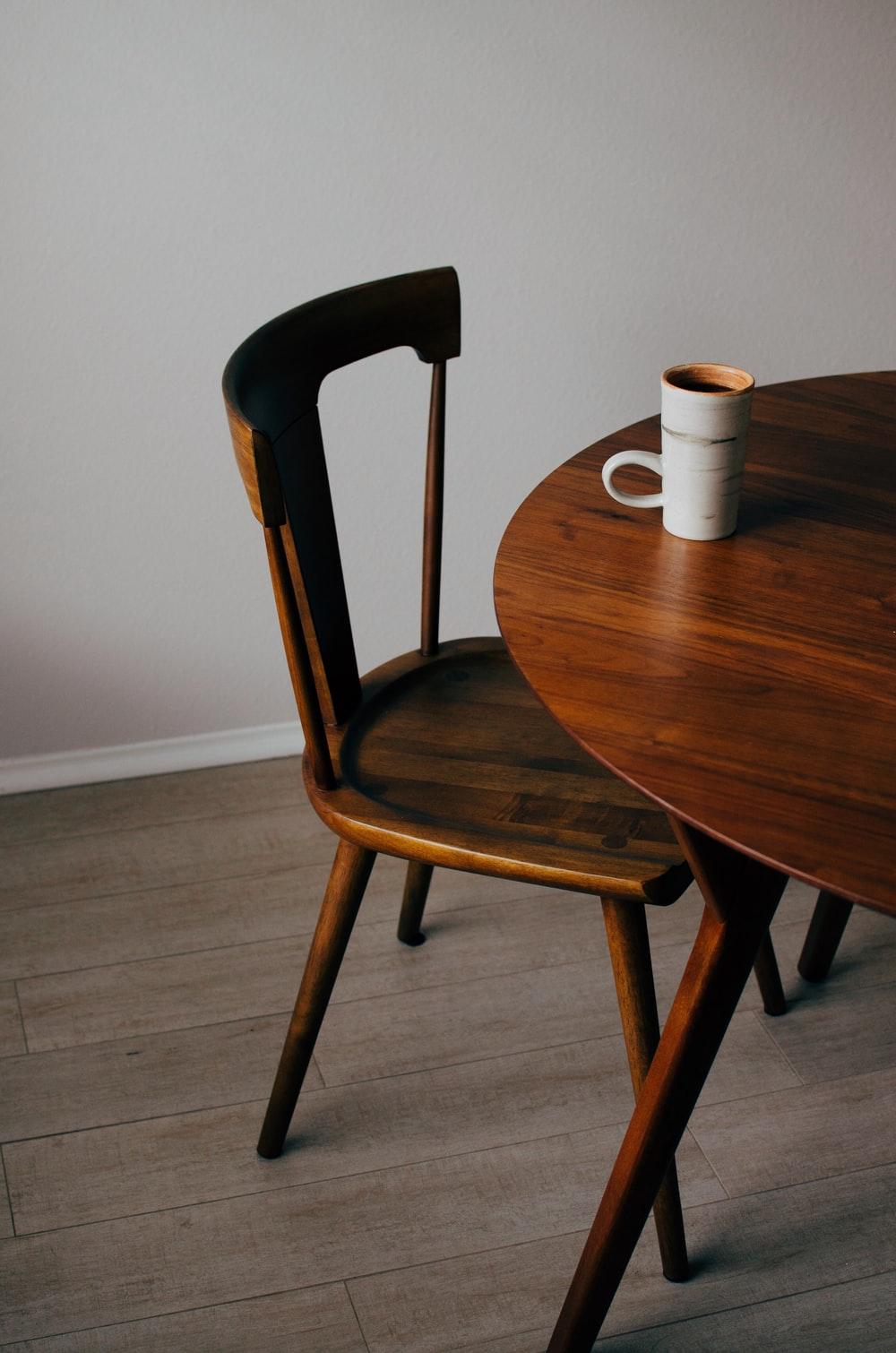 white ceramic mug on brown wooden table