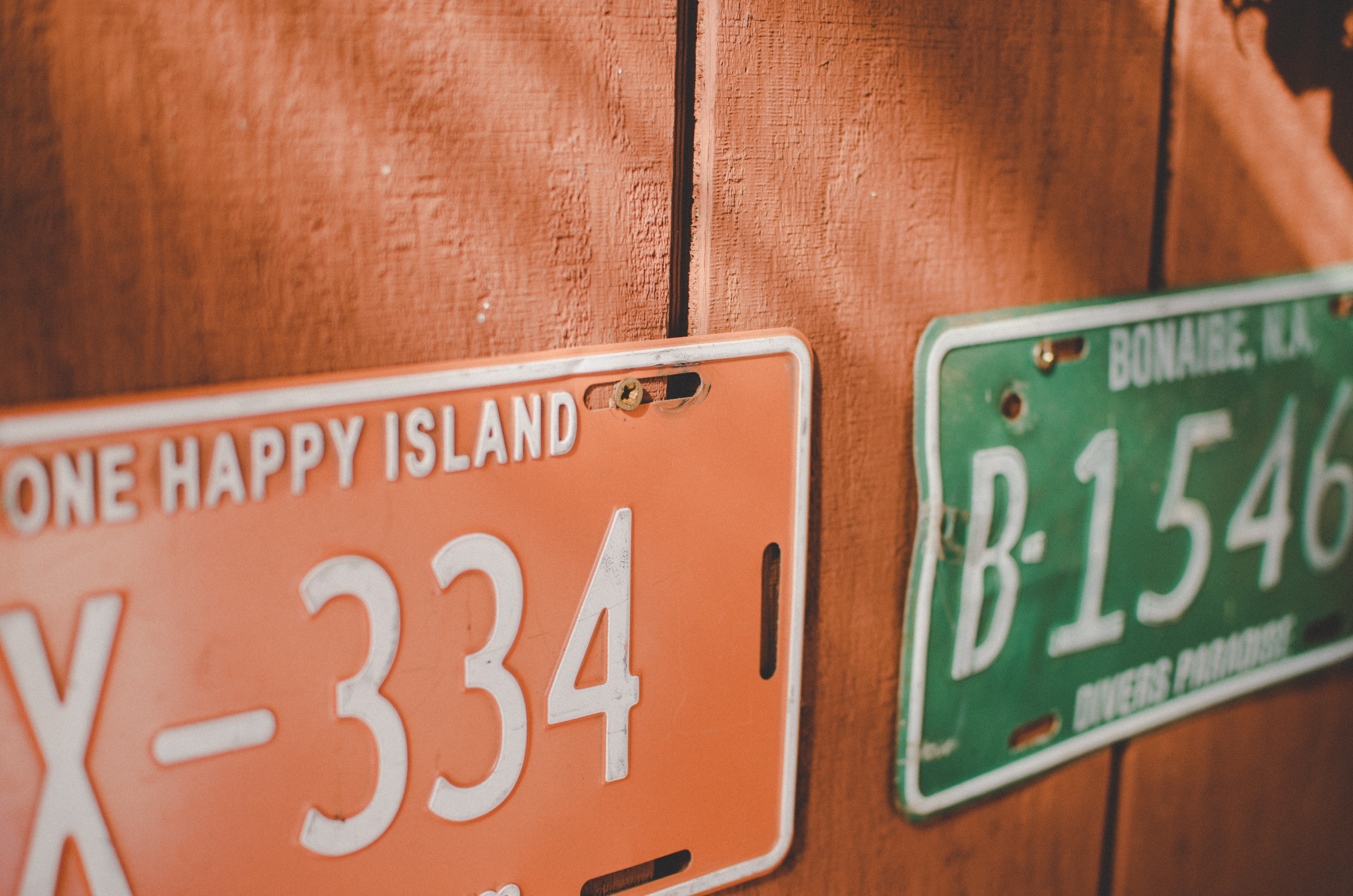 License plates on the orange wall in Carribean Netherlands.