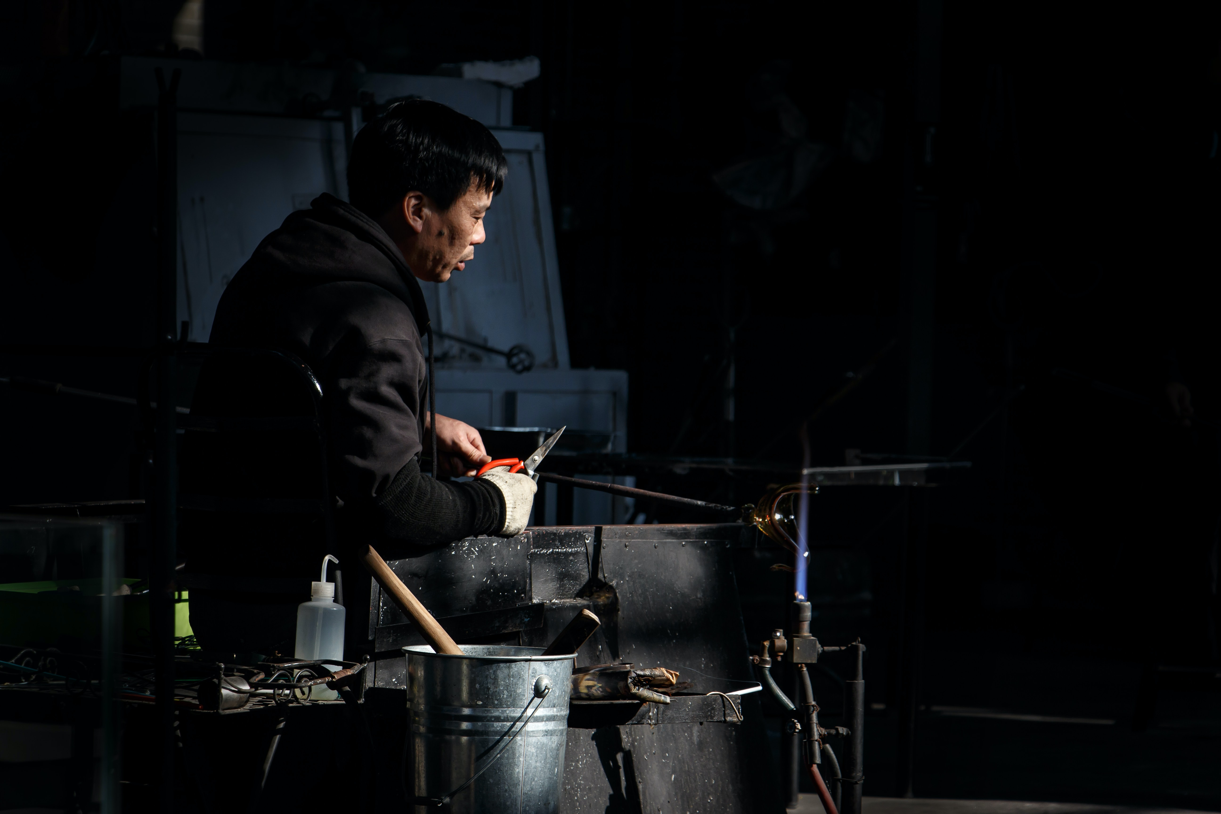 An Asian male looking at stuff at the Shanghai Museum of Glass