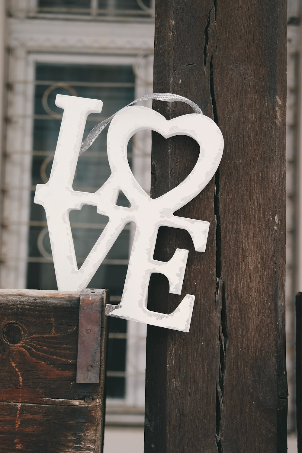 """A white sign that says """"LOVE."""""""
