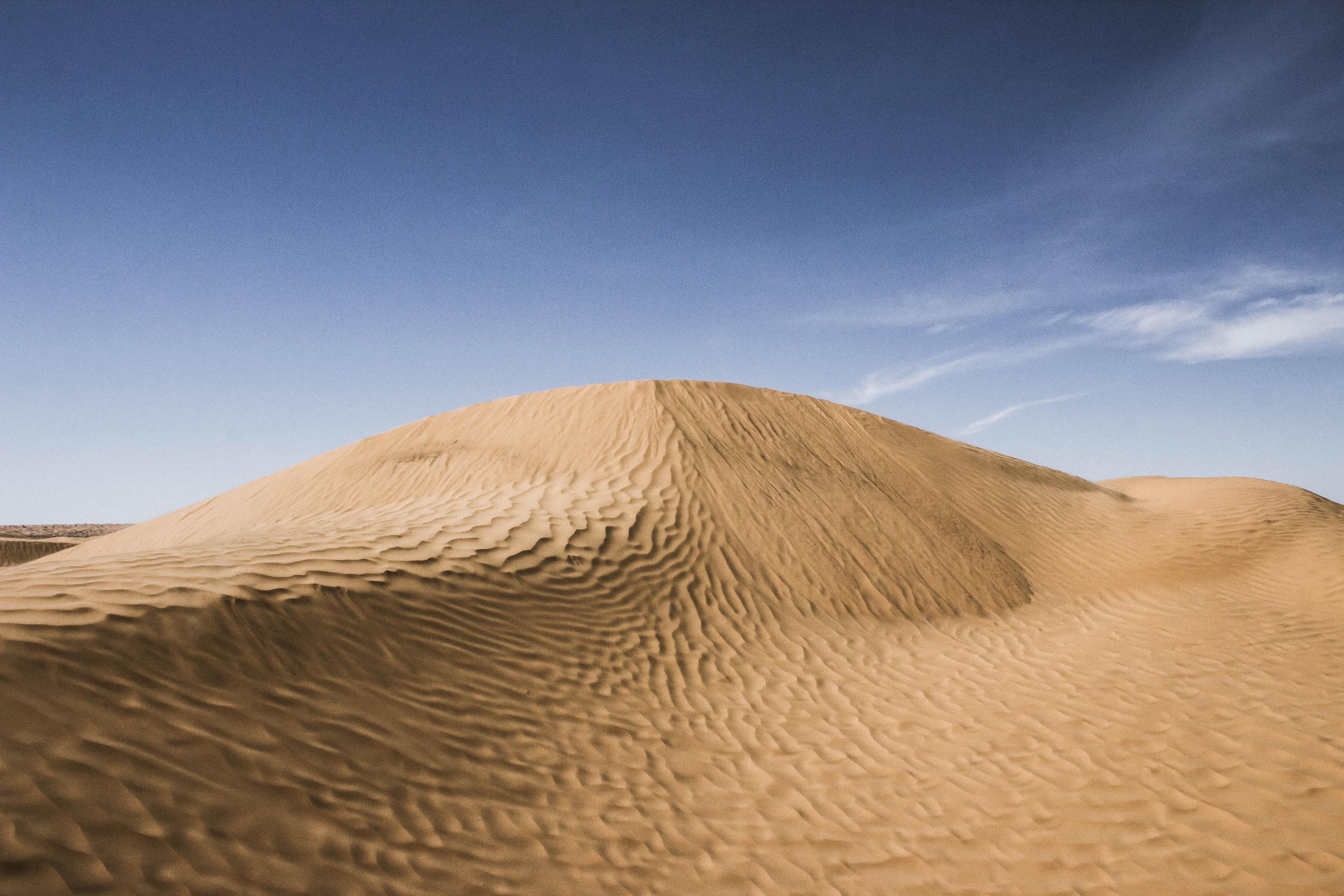 Sand ripples in the barren land of Ksar Ghilane desert