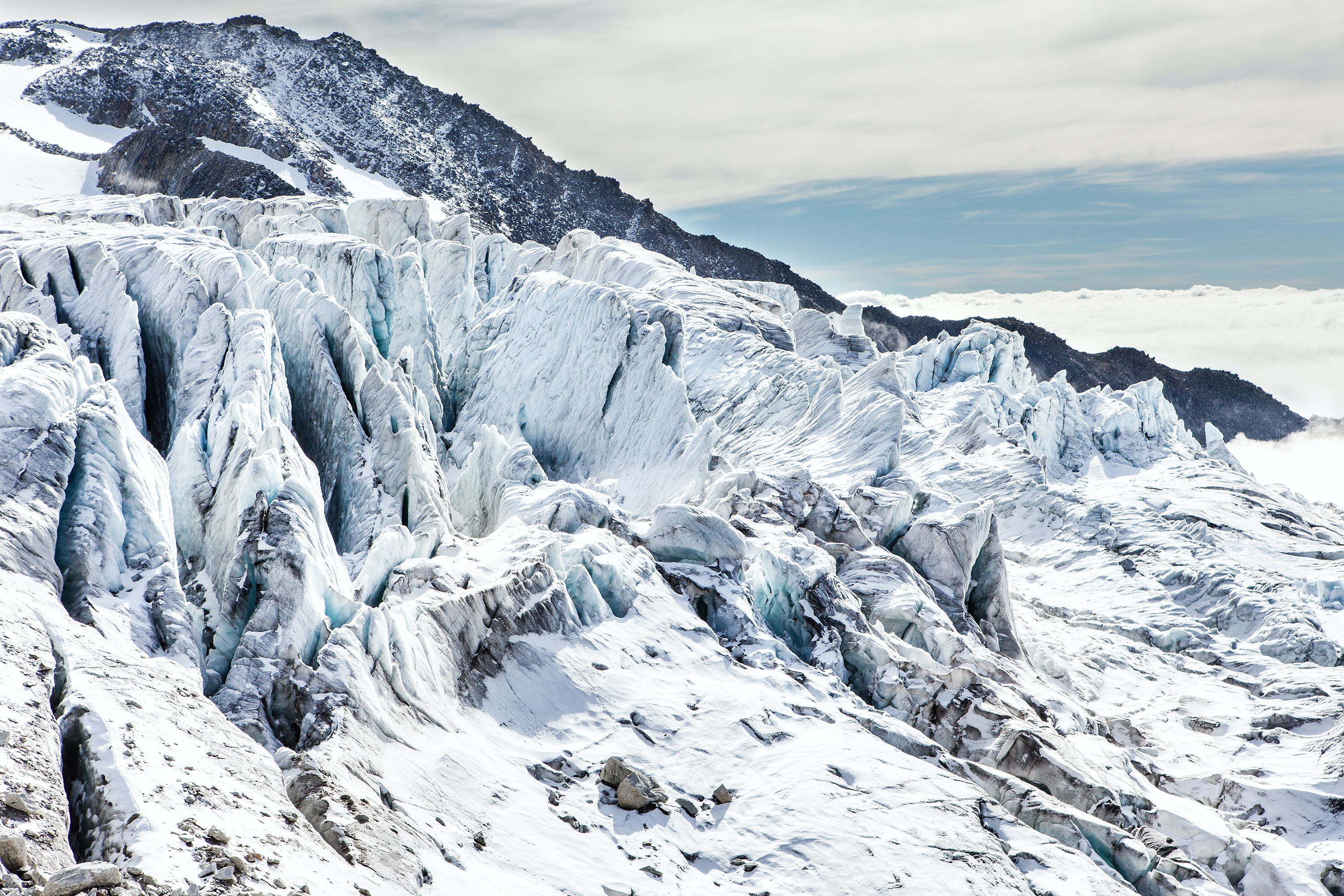 Snow and ice encapsulate and extremely rigid mountain