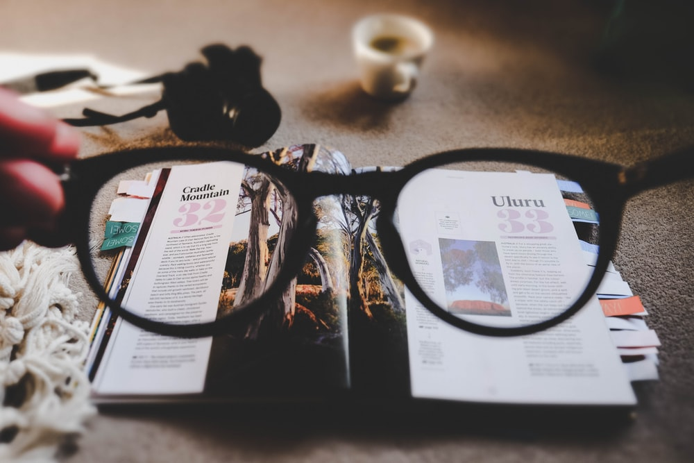 eyeglasses with brown frames and open book