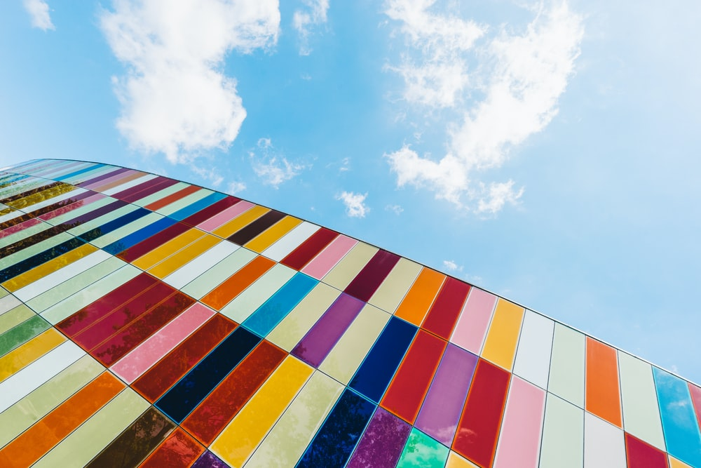 multicolored tinted glass architectural building in closeup photo