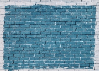 gray concrete bricks painted in blue