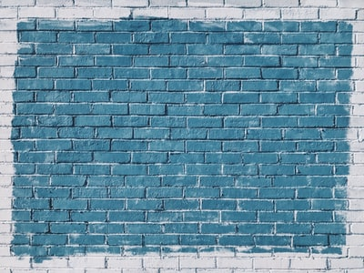 gray concrete bricks painted in blue colour teams background