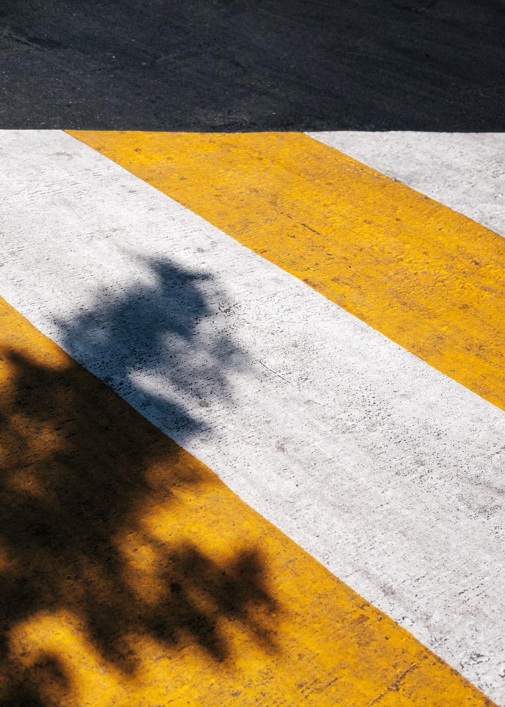 yellow and white pedestrian lane