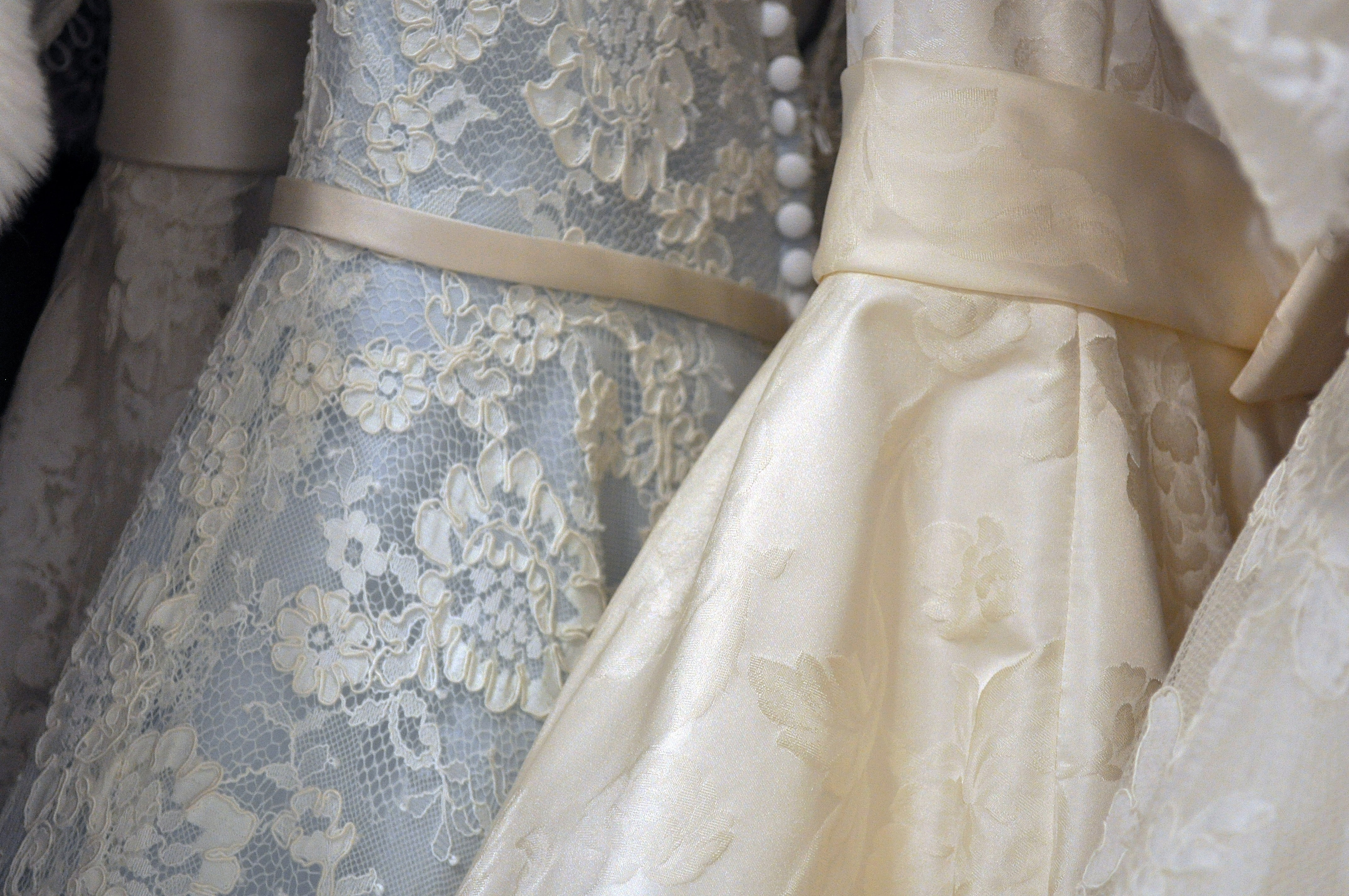 Multiple lace wedding dresses in a row