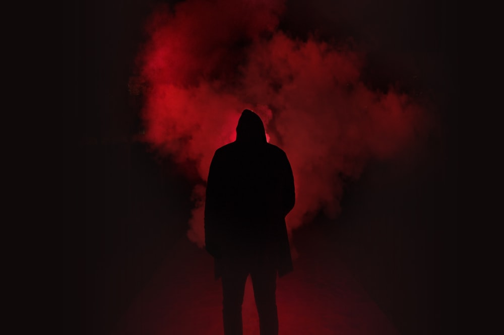 silhouette of person on a dark place with smoke