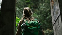 person wearing green backpack