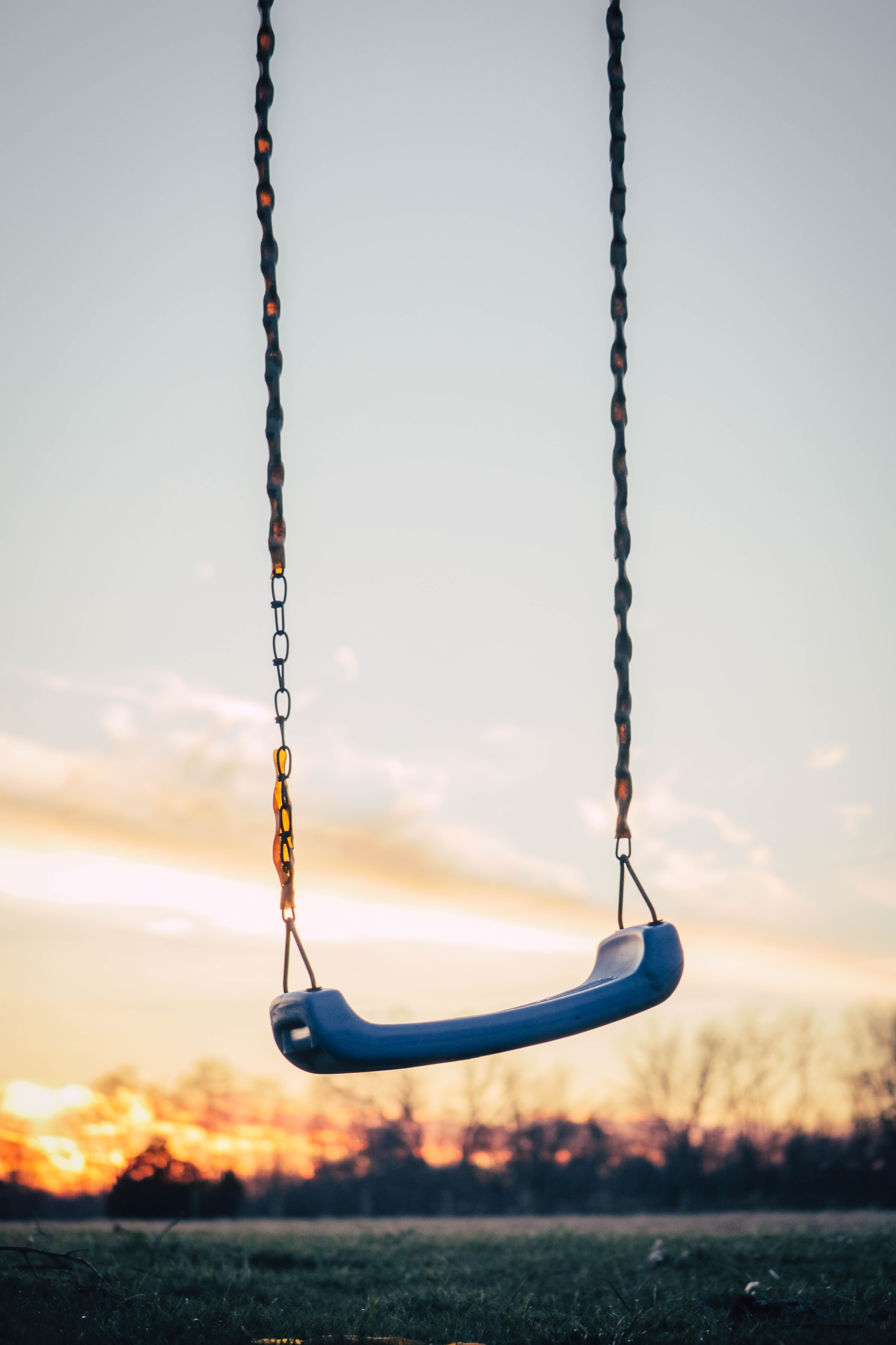 selective photography of blue plastic swing