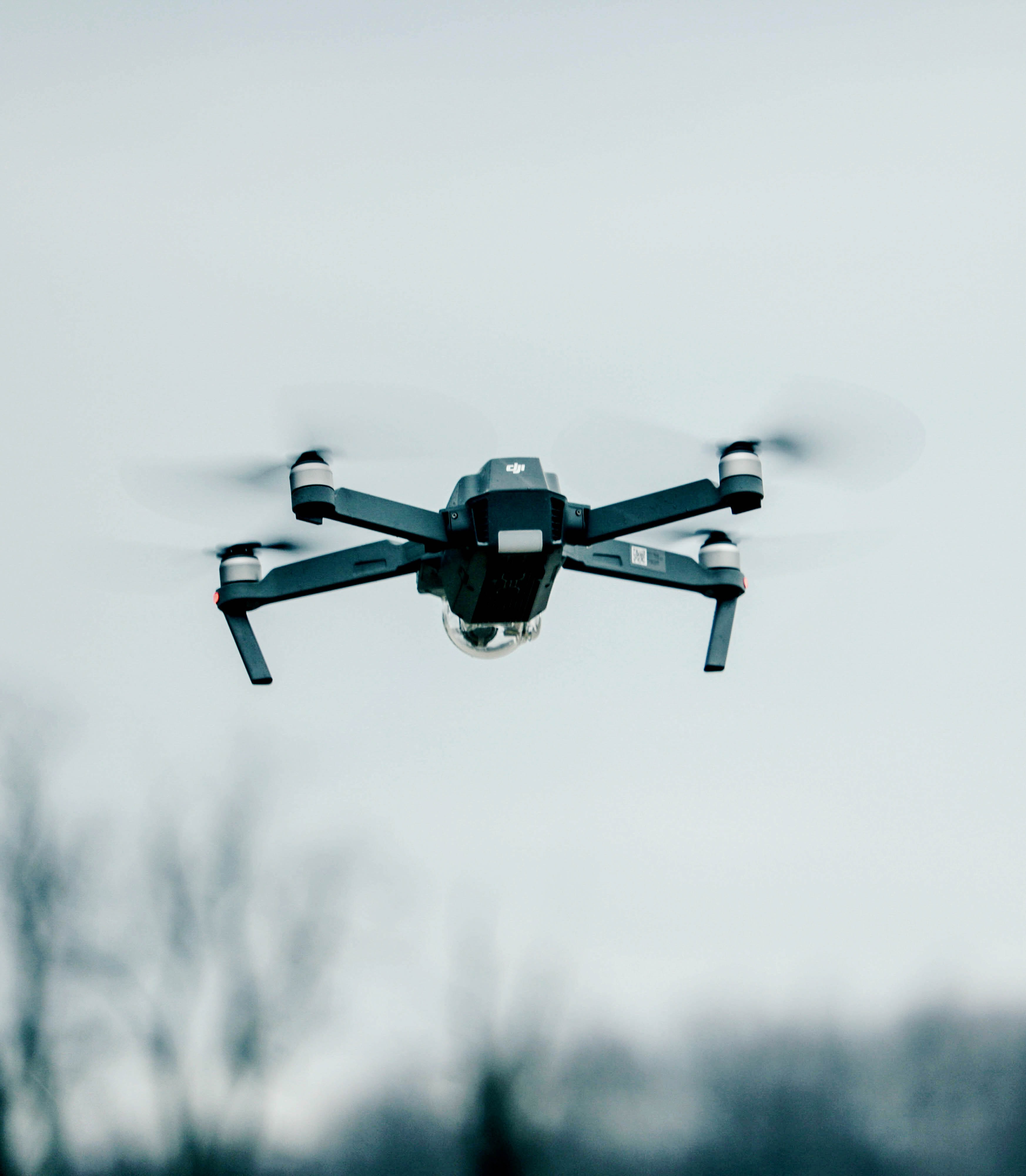 selective focus photography of flying quadcopter