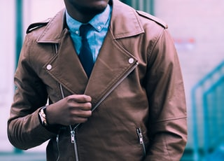 man in brown leather coat