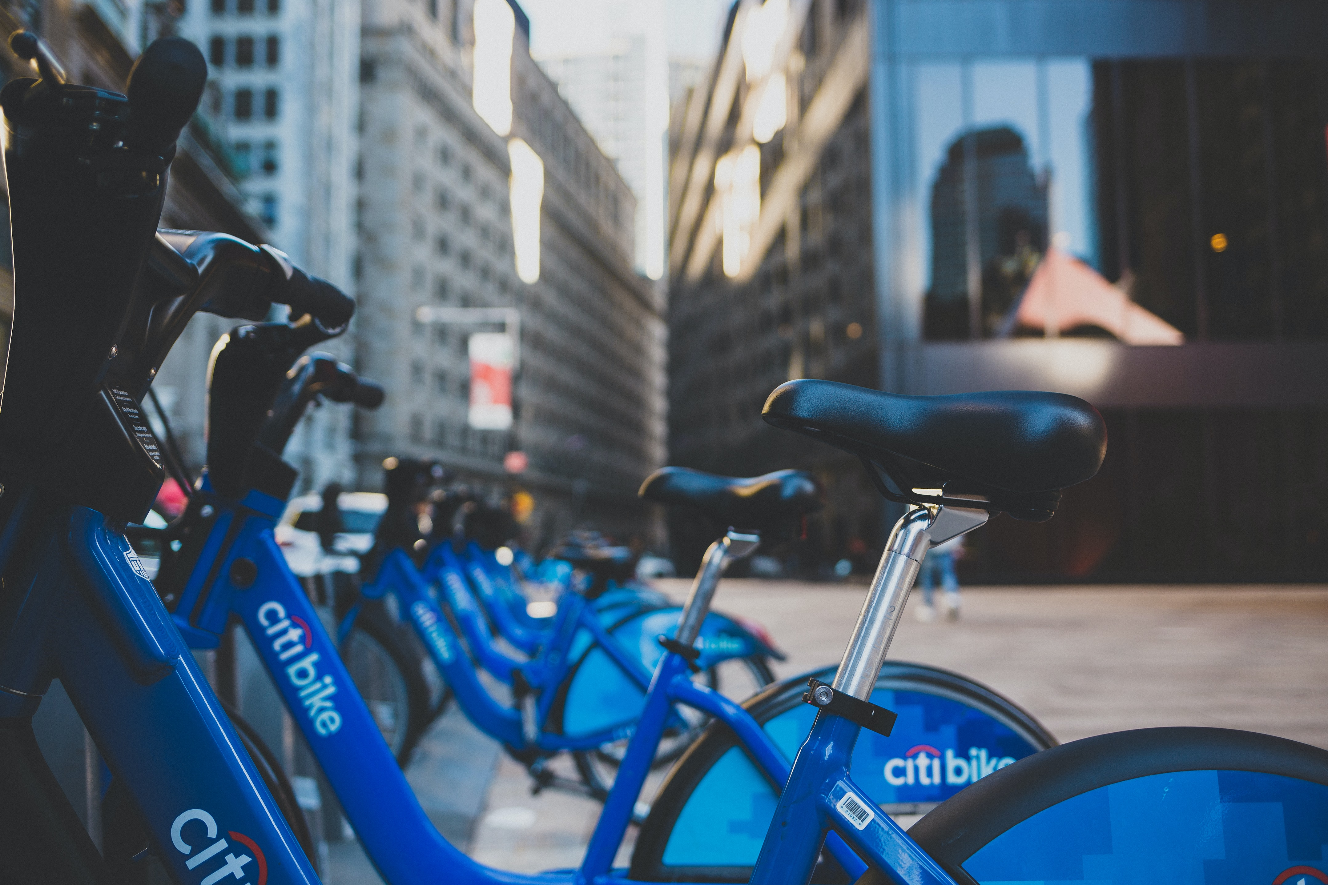 Blue Citibike bicycles are parked in a row at the World Trade Center.