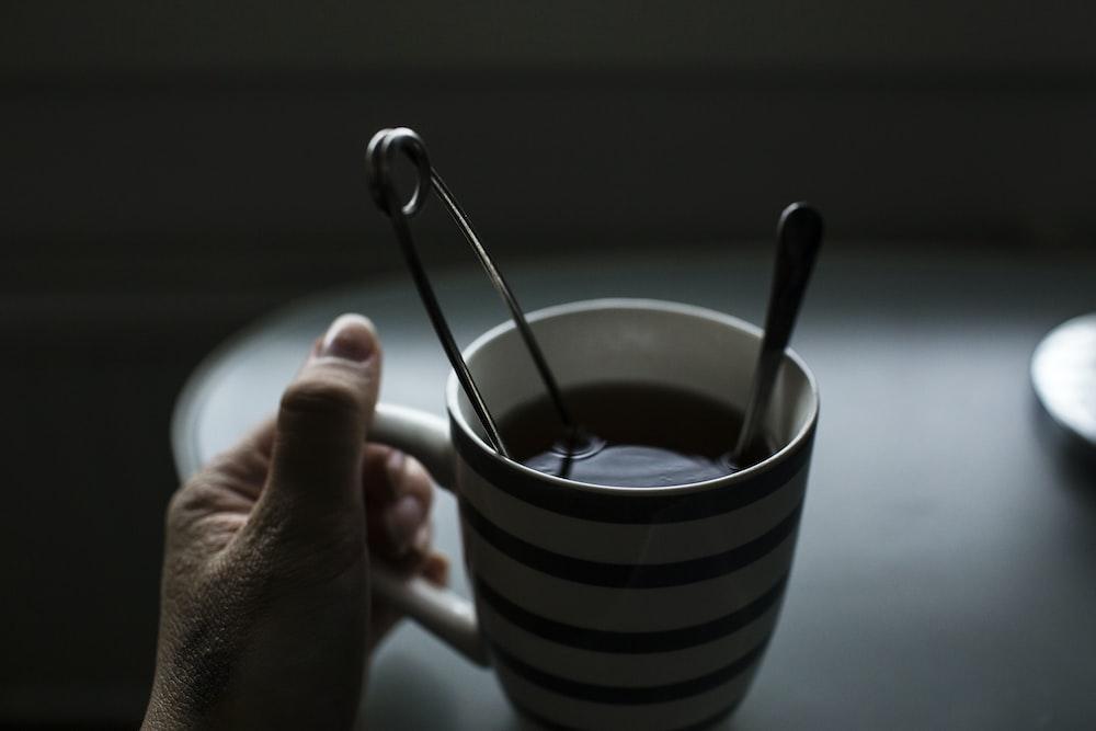black and white ceramic coffee mug