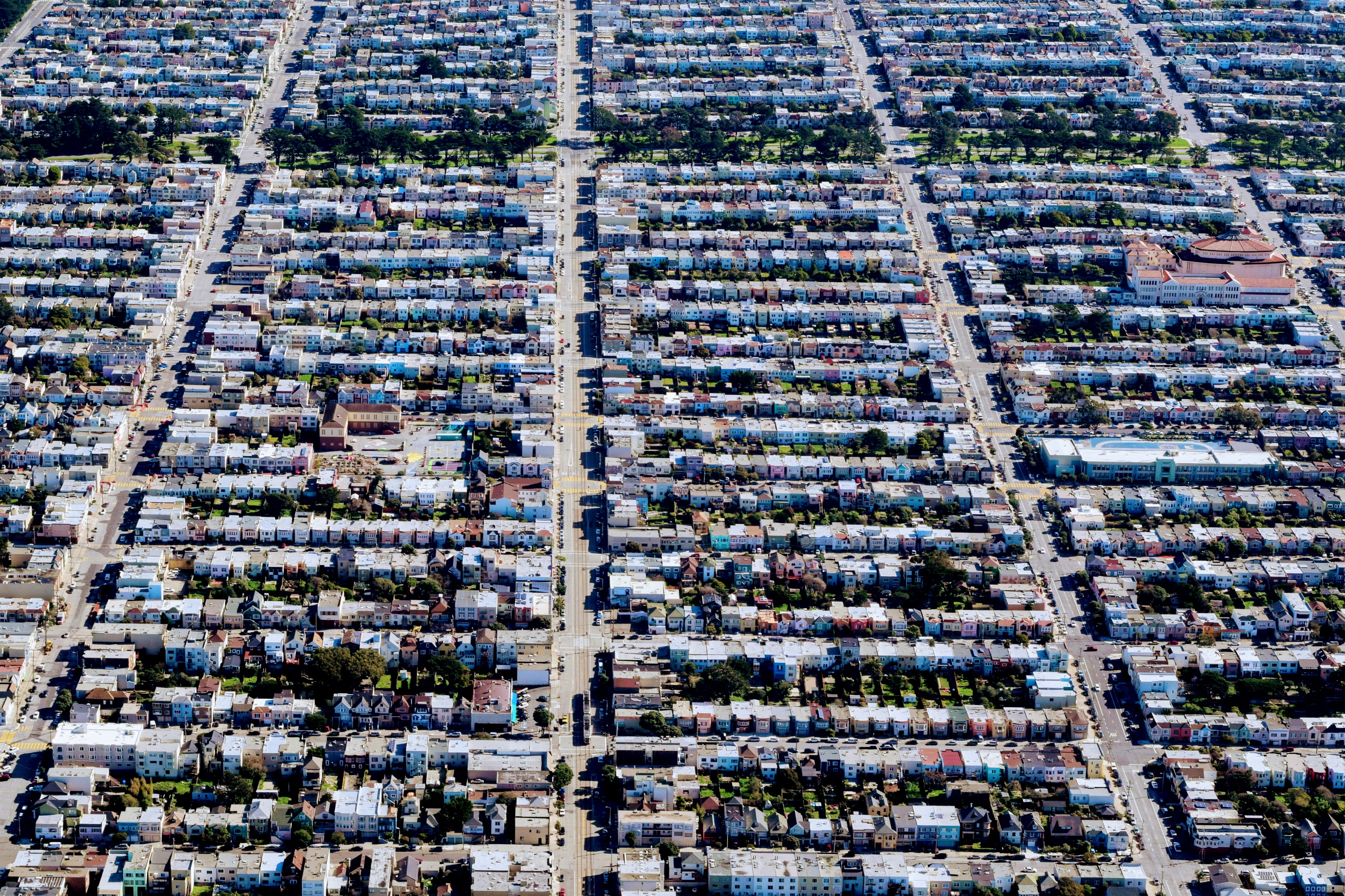 The view of the compact clusters of houses in a township from a drone.
