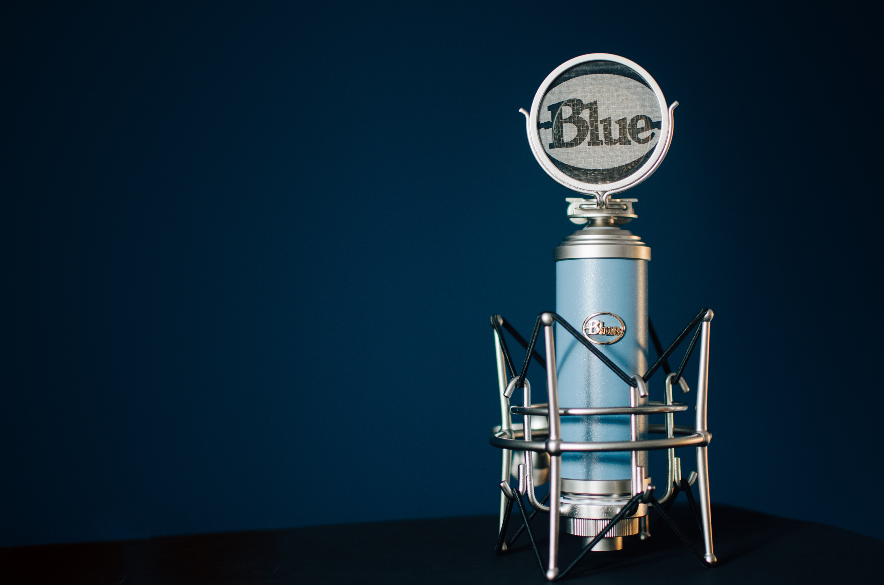 A Blue condenser microphone standing in the corner