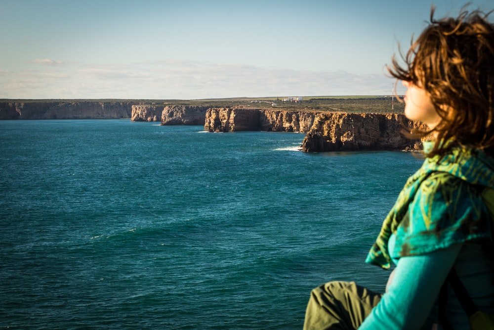 woman sitting at the seashore