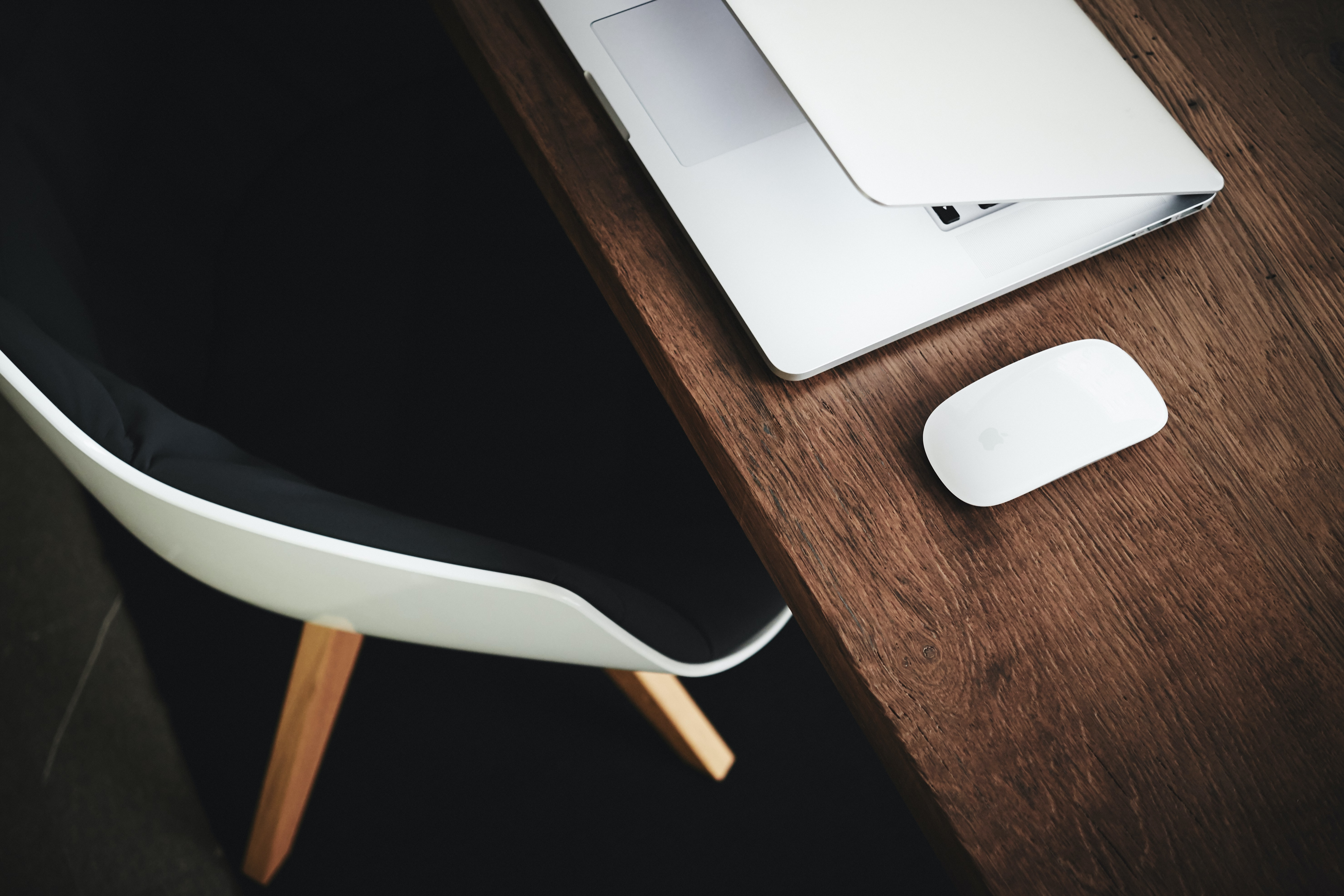 white Apple Magic mouse on brown table