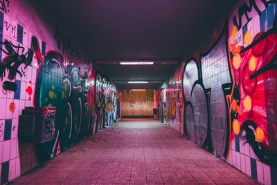 empty tunnel pathway with graffiti walls street zoom background