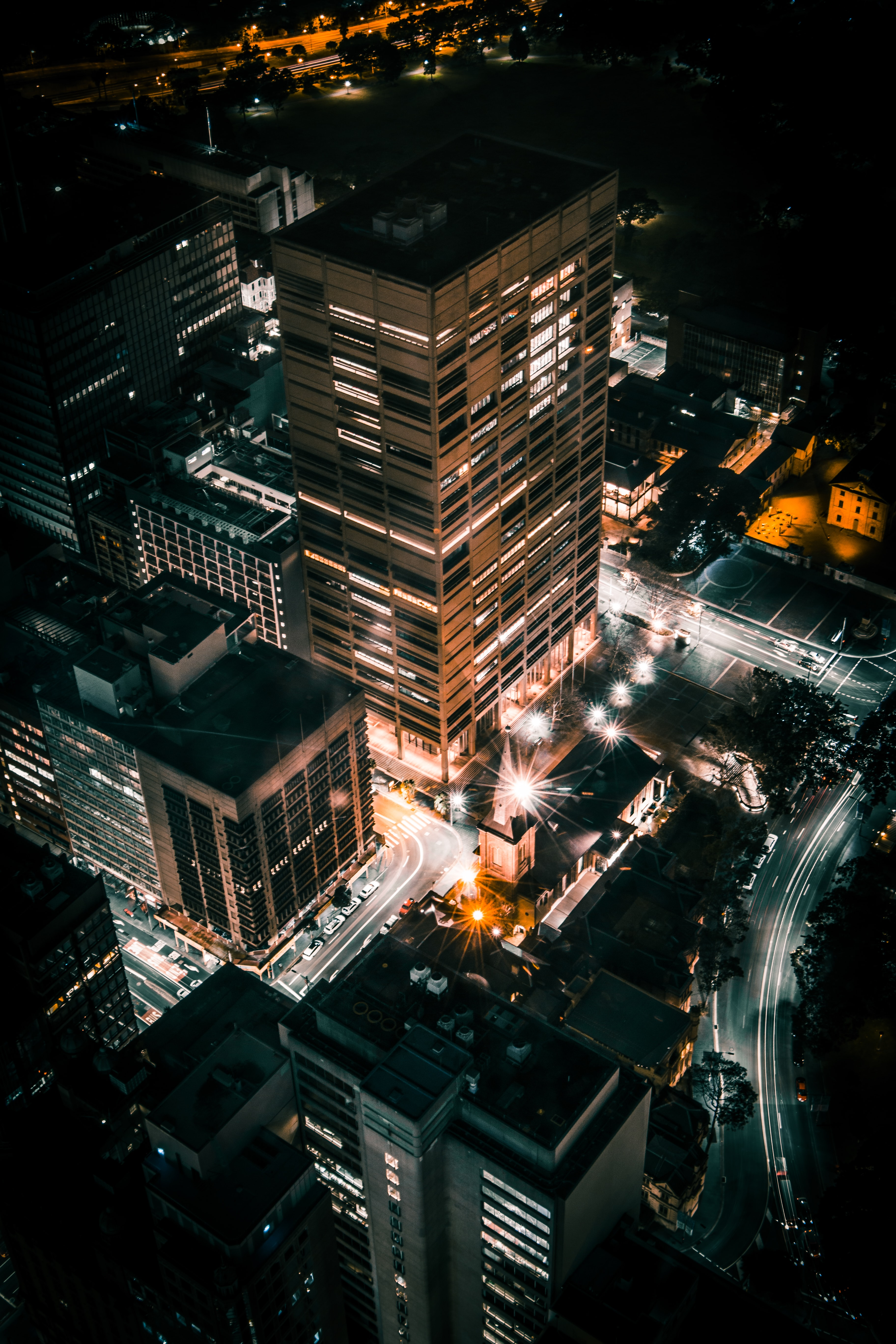 A high shot of tall office buildings in Sydney at night