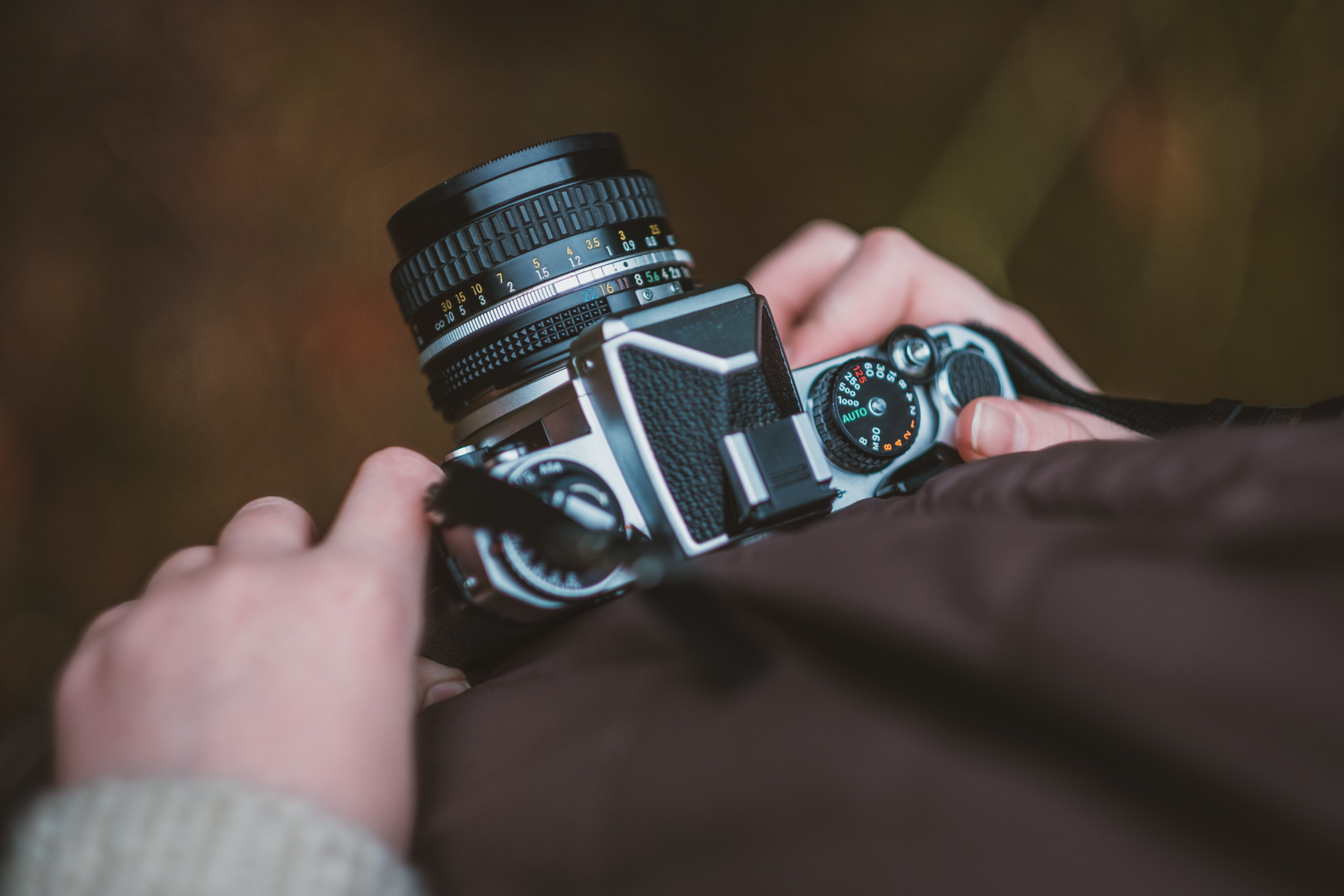 selective focus photography of person carrying camera