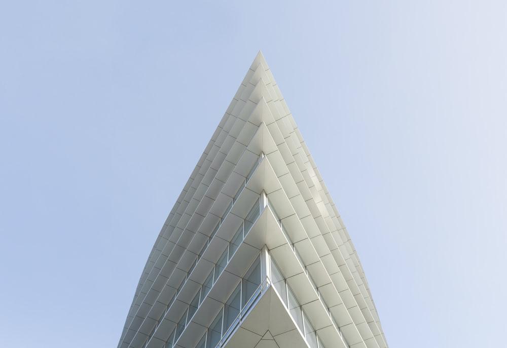 white building top under white skies