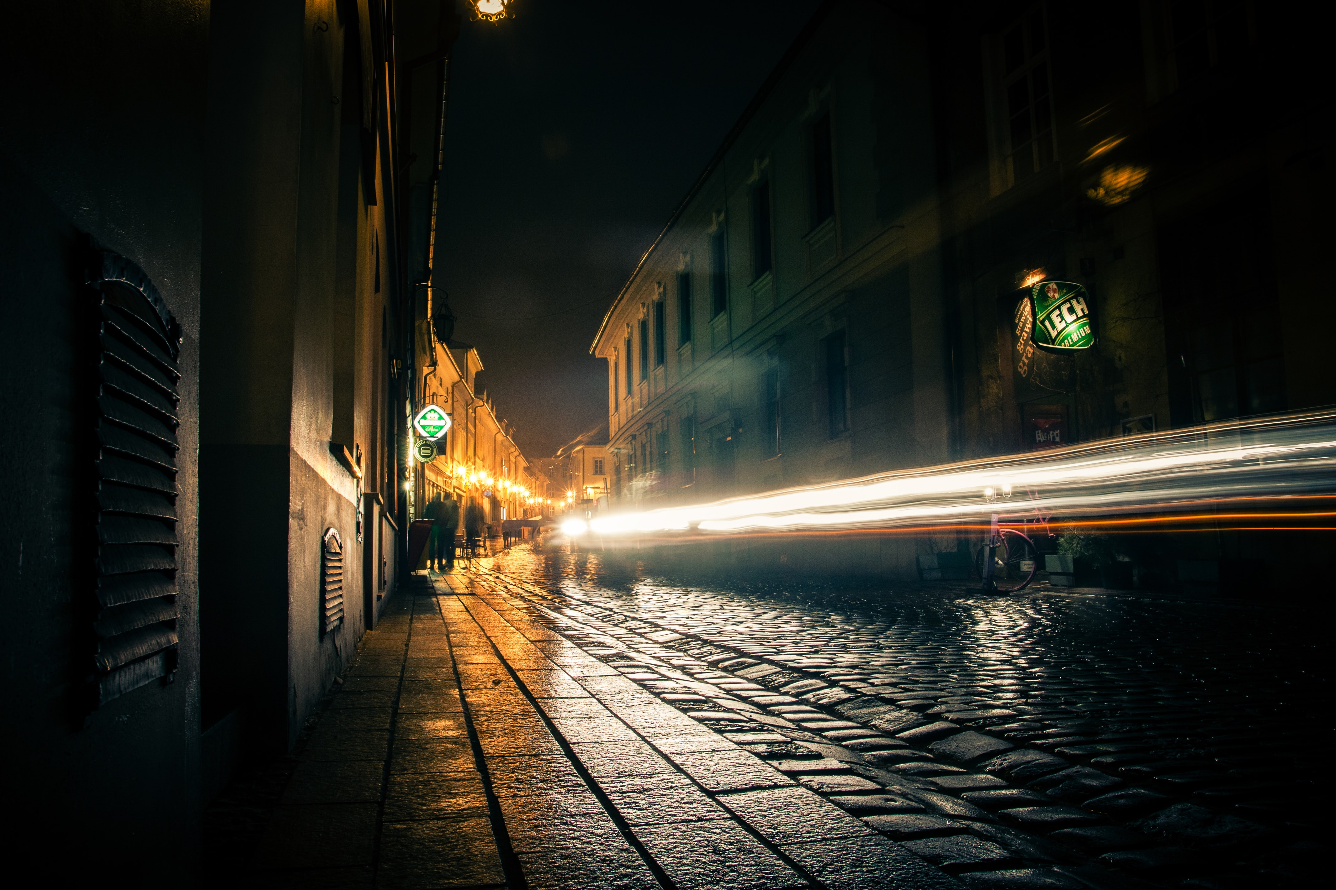A slow shutter shot of a motion-triggered light trail in a backstreet alley