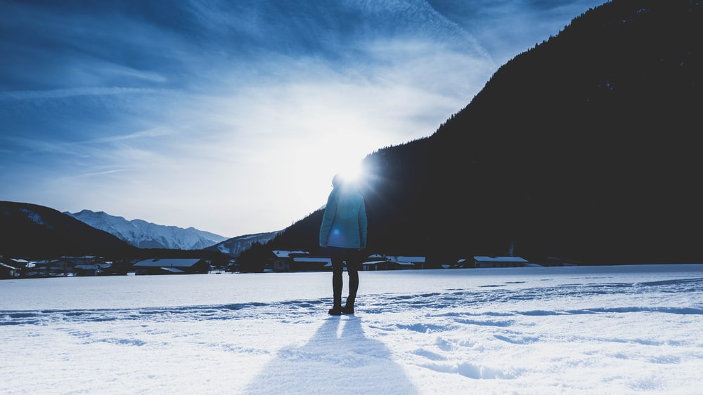 person standing on snow land