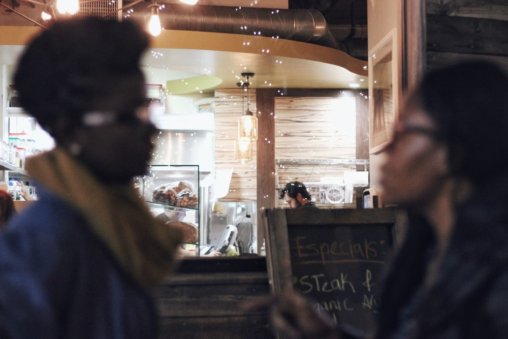 two women wearing eyeglasses in room