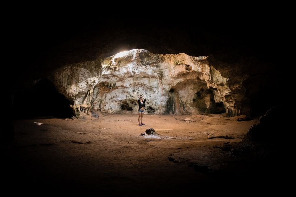 person standing in cave