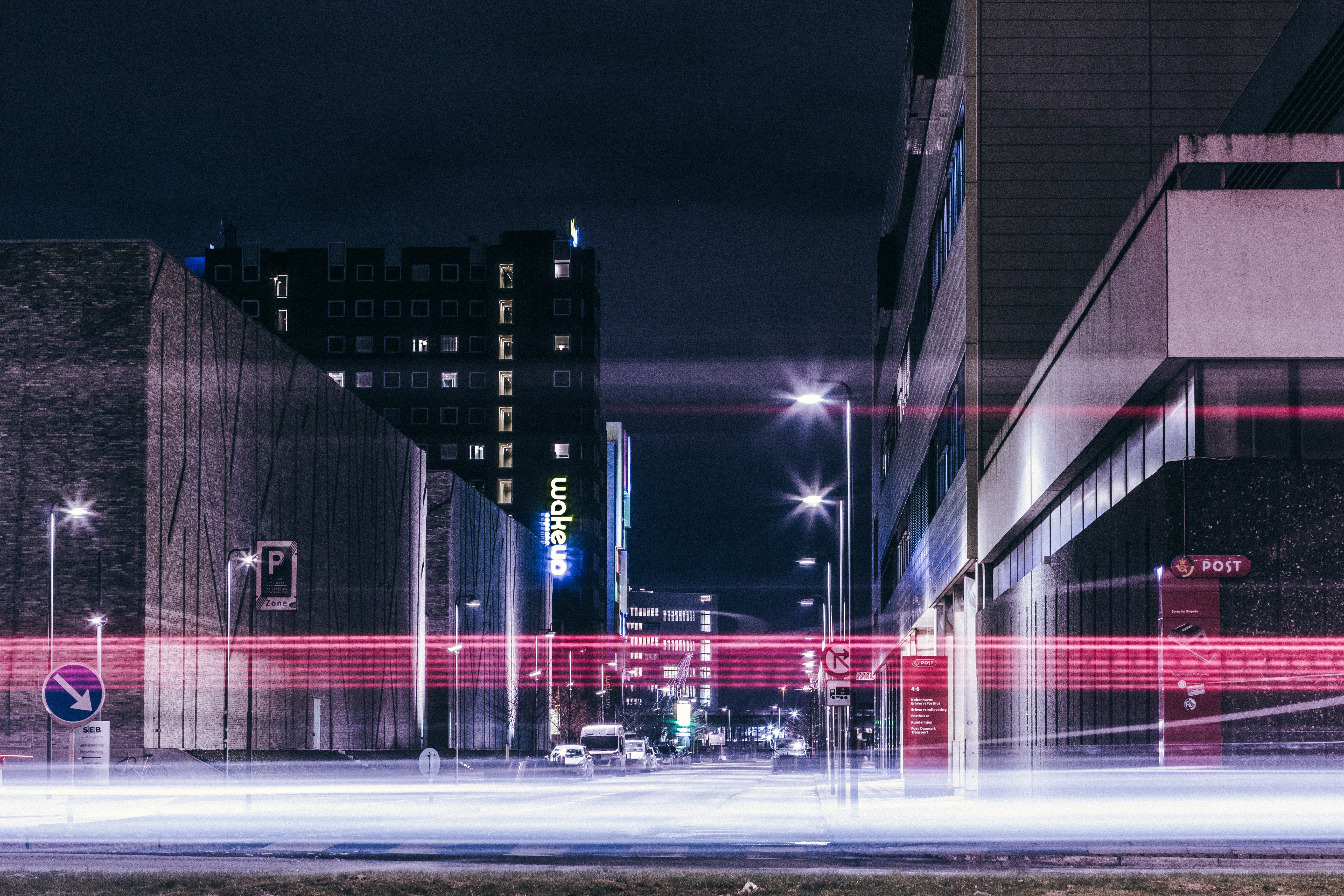 A long-exposure shot of light trails in a street in Copenhagen at night