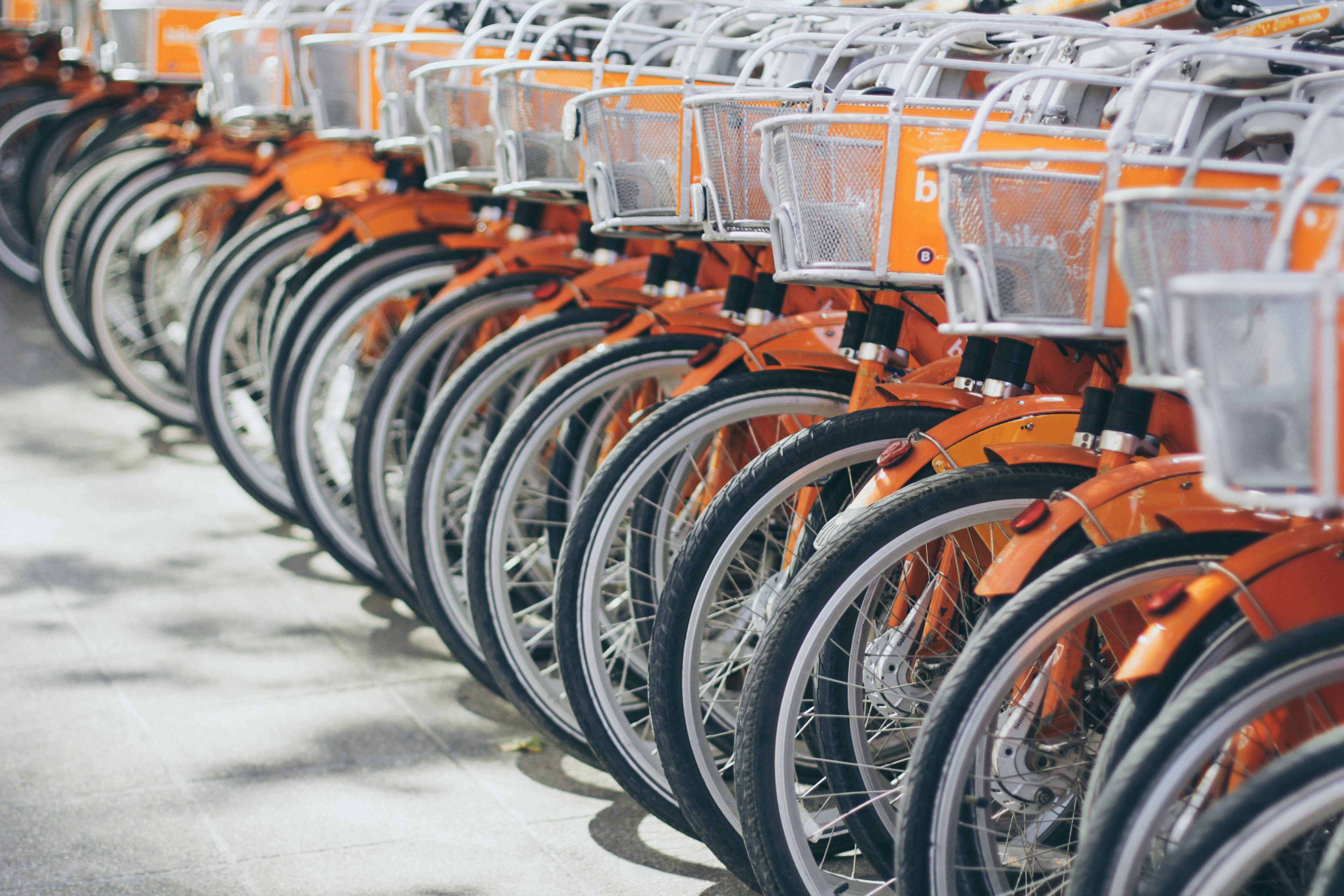 A long row of orange rental bicycles in Santiago