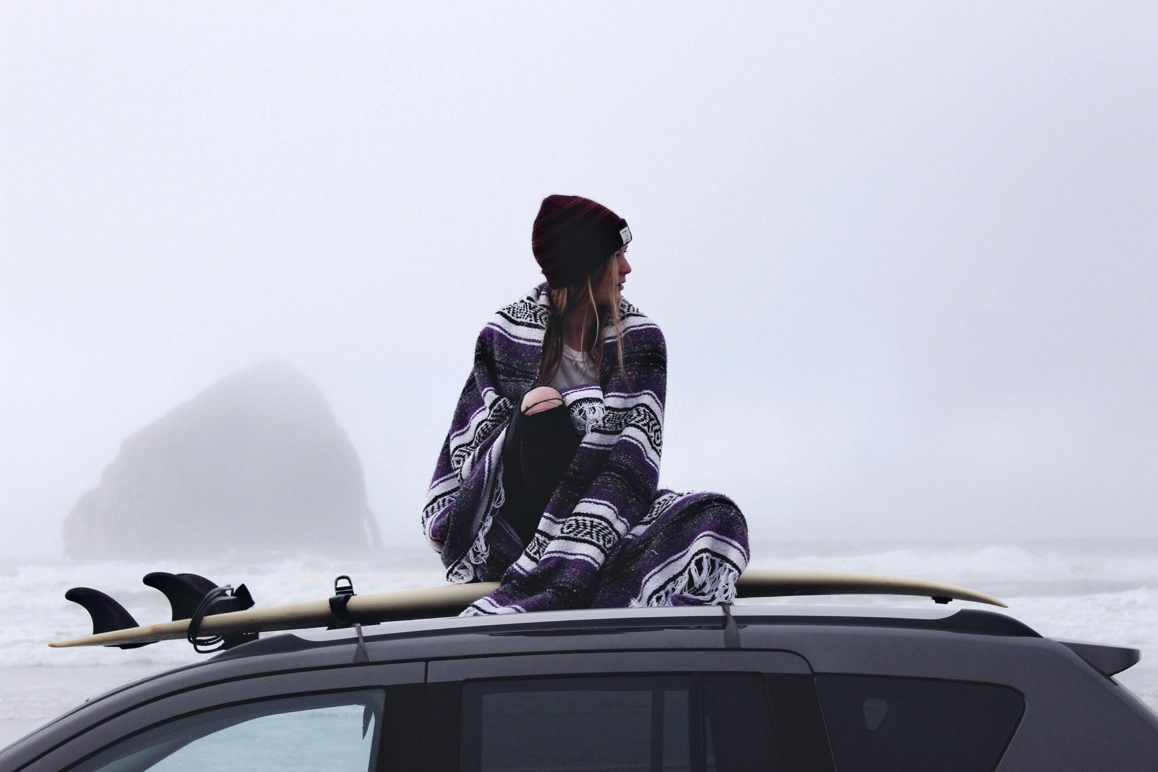woman sitting black car