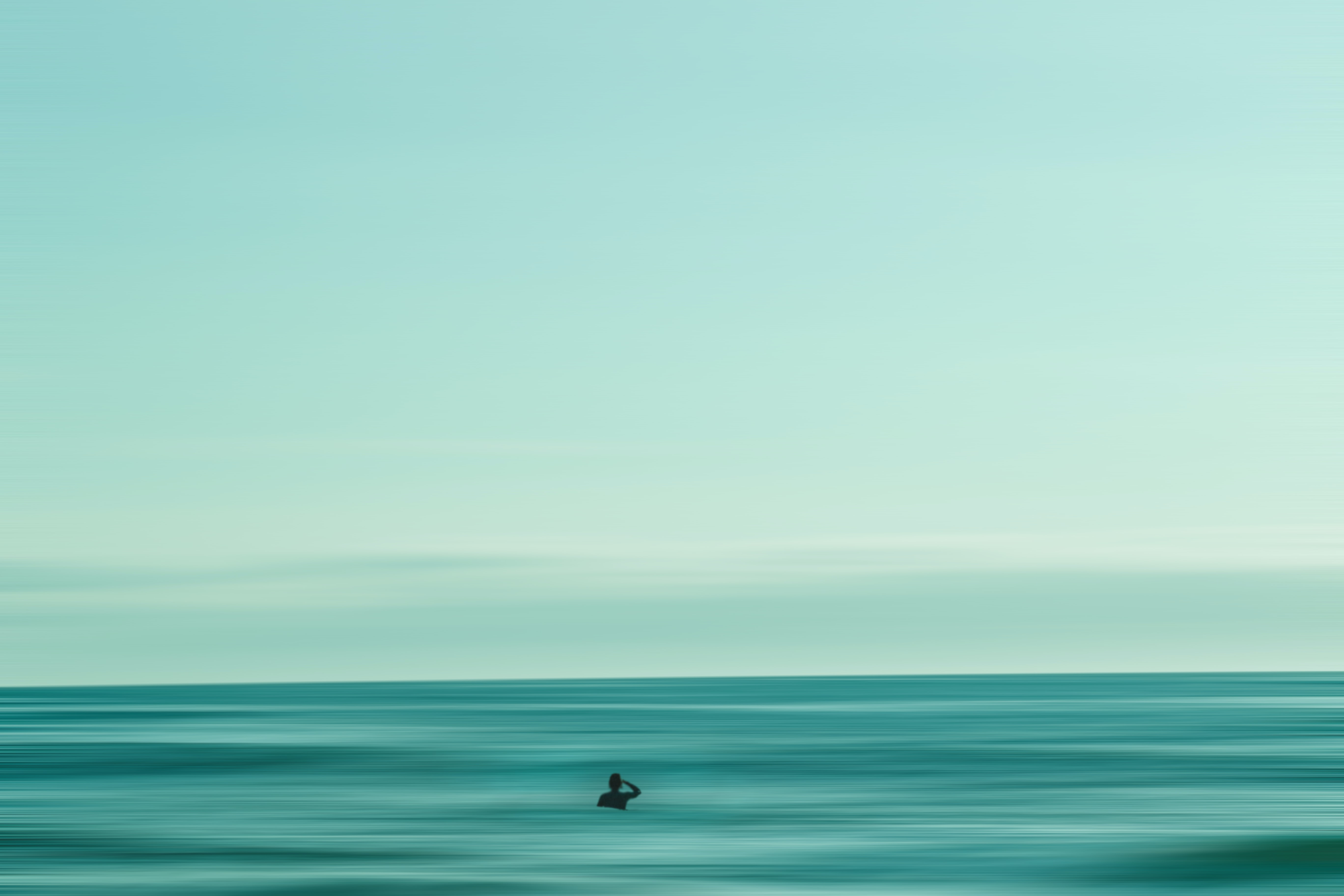 A person swimming in the ocean in San Clemente