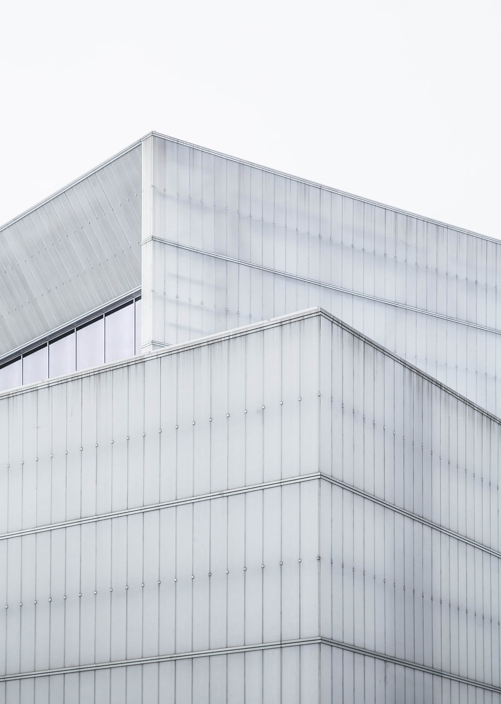 gray wall paint building during daytime