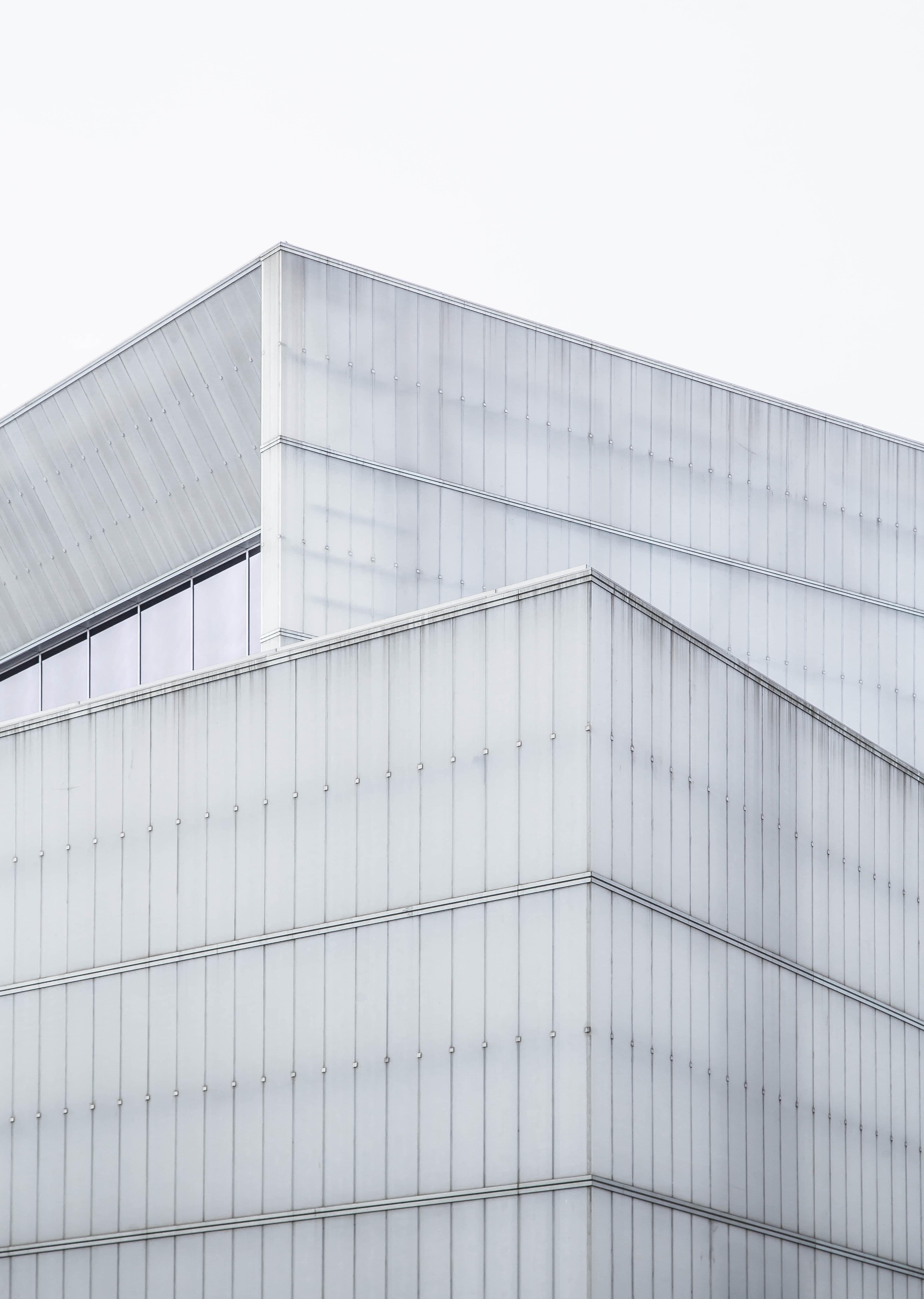 The top edge of a gray building facade