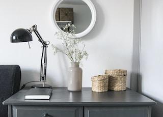 black desk lamp on black wooden drawer