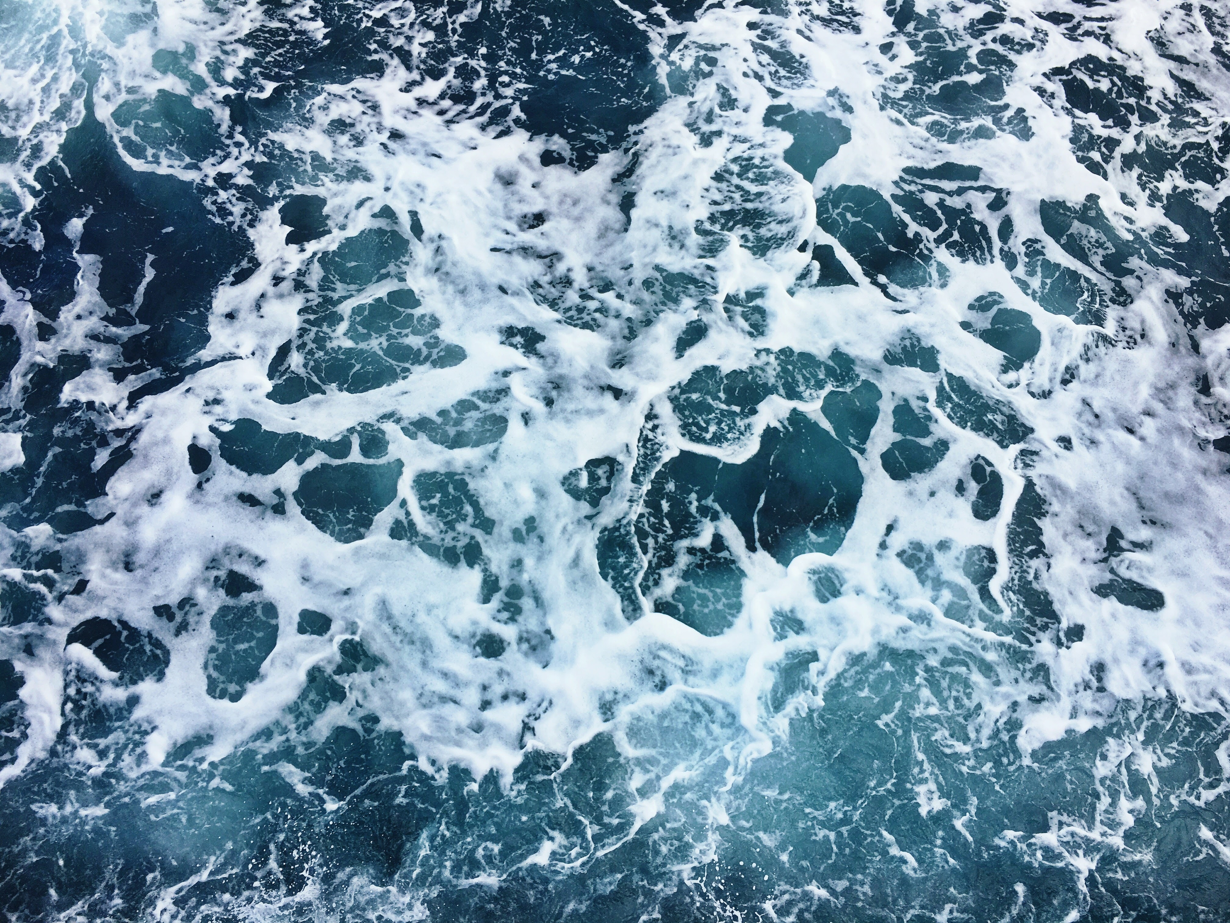 aerial photography of sea foam during daytime