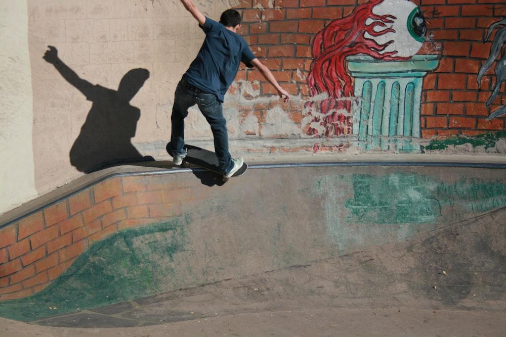 man skateboarding on concrete rail